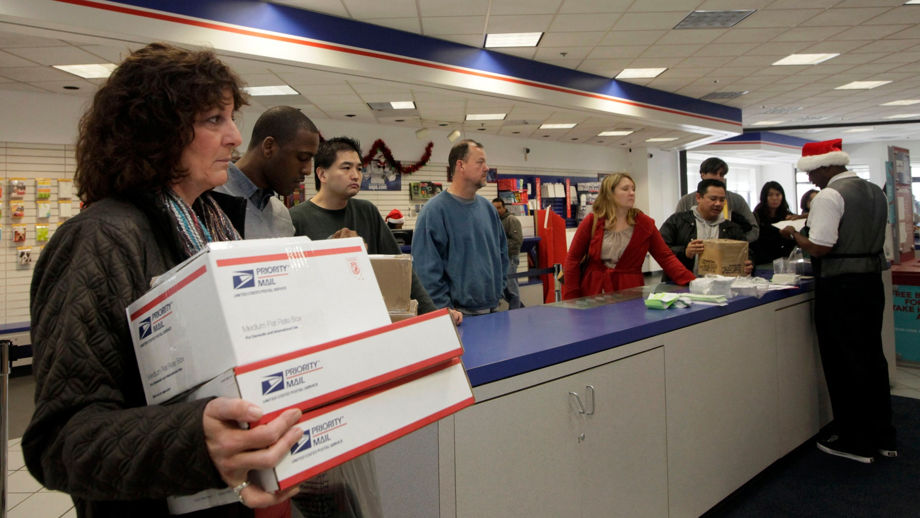 Dec. 19, 2011: This file photo shows people in line at the U.S. Postal Service Airport station in Los Angeles.