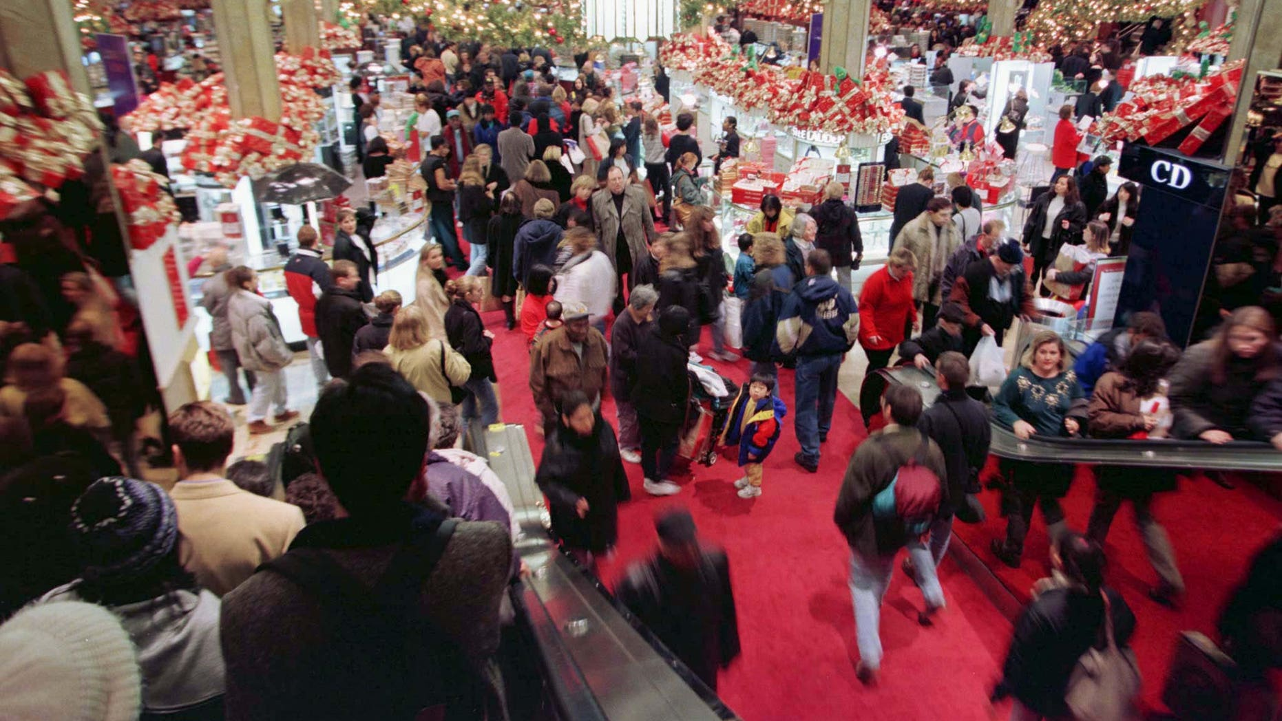 "Shoppers careen through the main floor at Macy's department store in New York on November 28, the official start of the holiday shopping season. Retailers dub the day ""Black Friday"" in hope that sales will turn into the black ink of profits for the all-important retail season. - RTXH3SJ"
