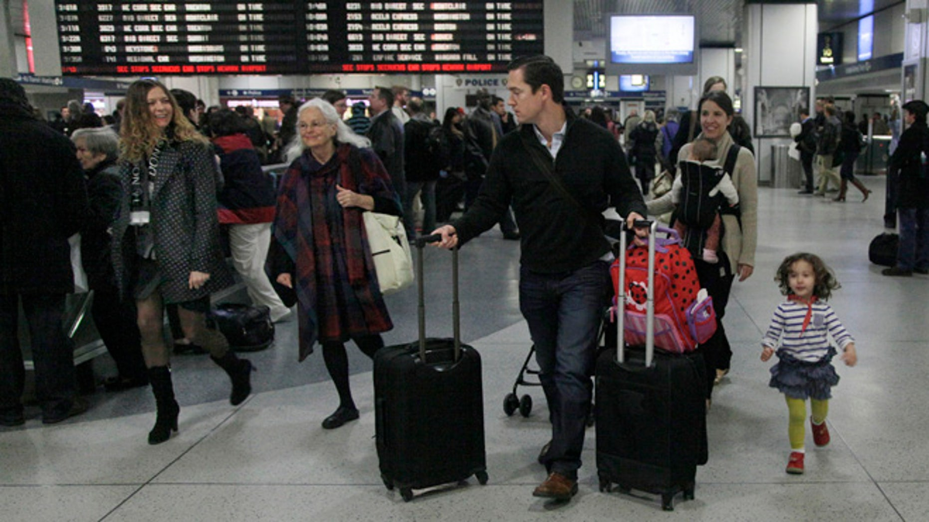 Nov. 21, 2012: Travelers walk through New York's Penn Station.
