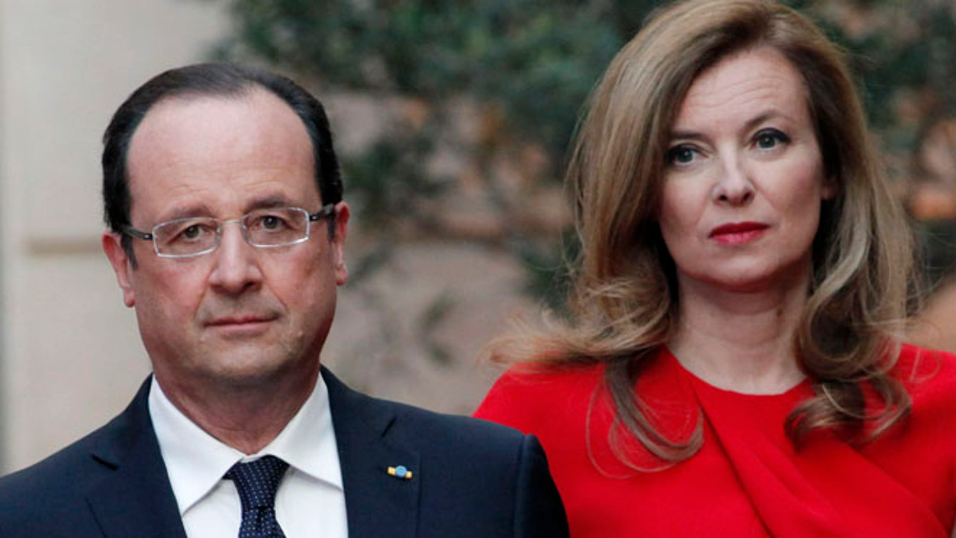 May. 7, 2013: In this file photo, French President Francois Hollande, left, and his companion Valerie Trierweiler arrive for a state dinner at the Elysee Palace, in Paris as part of Polish President Bronislaw Komorowski's two-day visit to France.