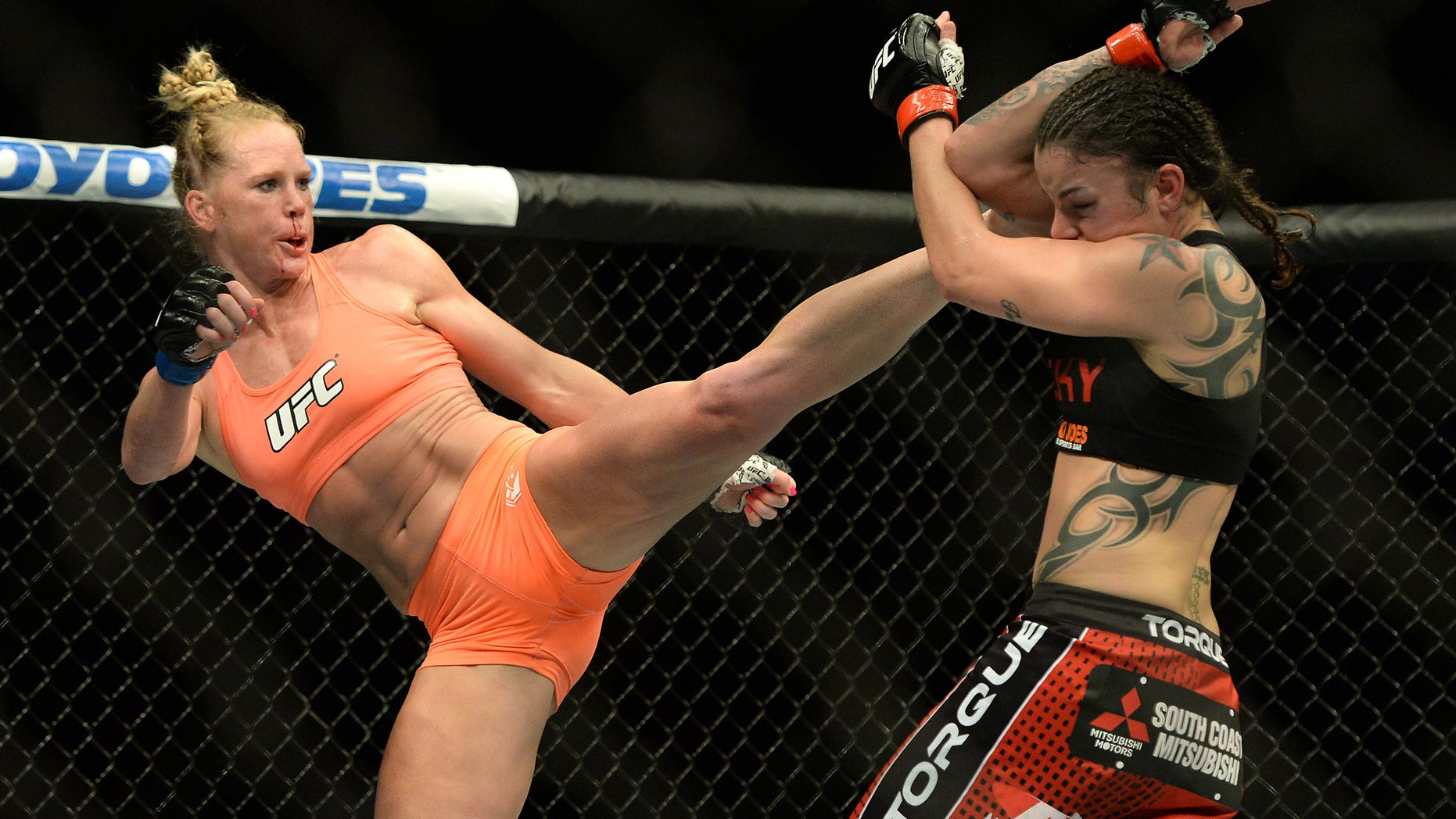 Feb 28, 2015; Los Angeles, CA, USA; Raquel Pennington (red gloves) and Holly Holm (blue gloves) during their women's bantamweight bout at UFC 184 at Staples Center. Mandatory Credit: Jayne Kamin-Oncea-USA TODAY Sports - RTR4RL8T