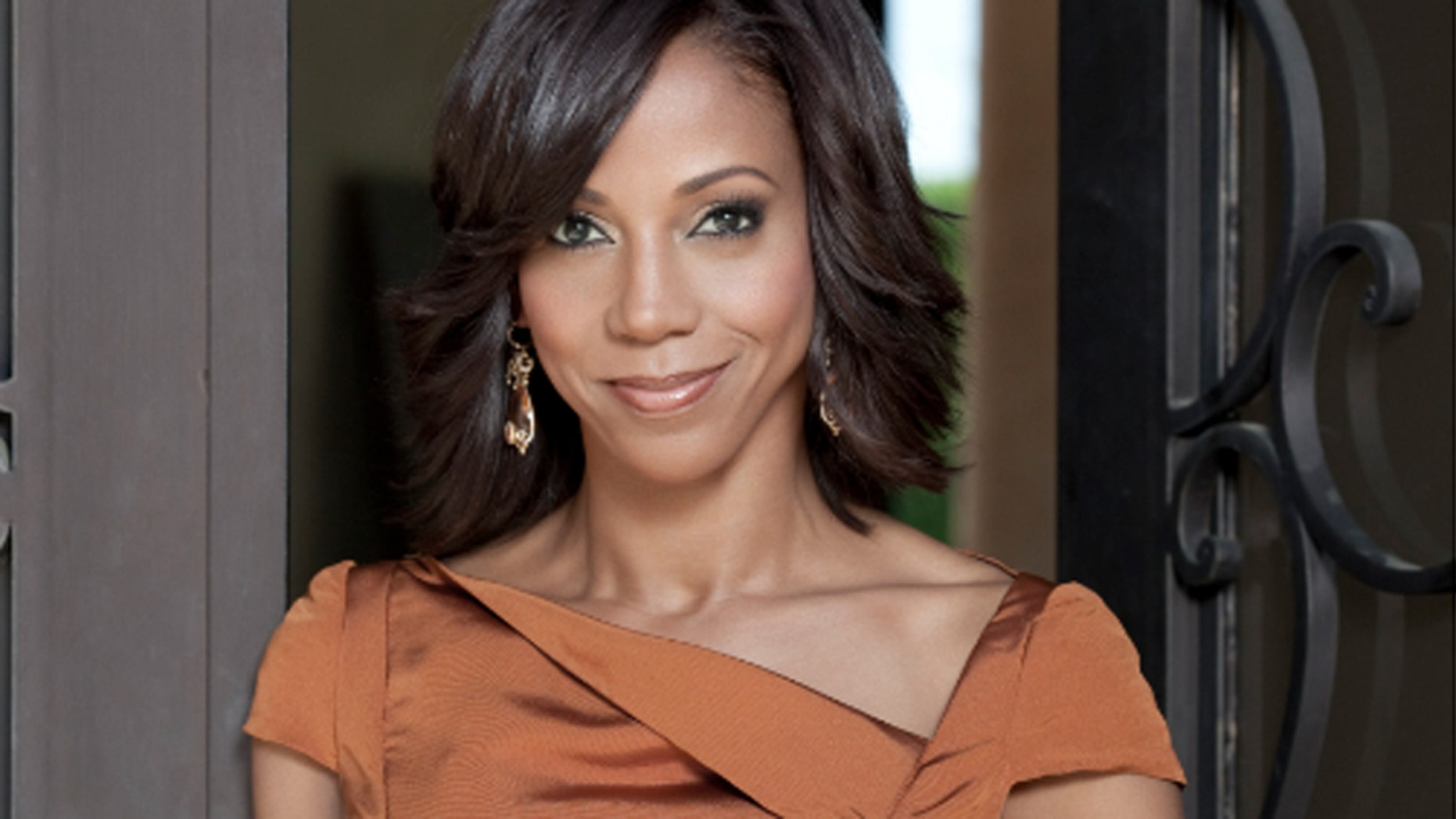 Holly Robinson Peete poses for a photo.