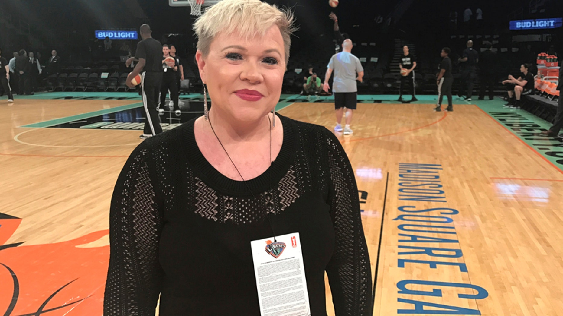 Holly Rowe stands on the court at Madison Square Garden in New York before a WNBA basketball game between the New York Liberty and the Minnesota Lynx, Thursday, May 18, 2017.
