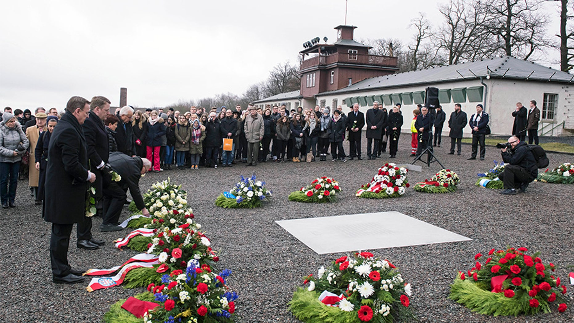 People mourn on occasion of the international Holocaust remembrance day (Jan.27) in the former Nazi concentration camp Buchenwald near Weimar, Germany, Friday.