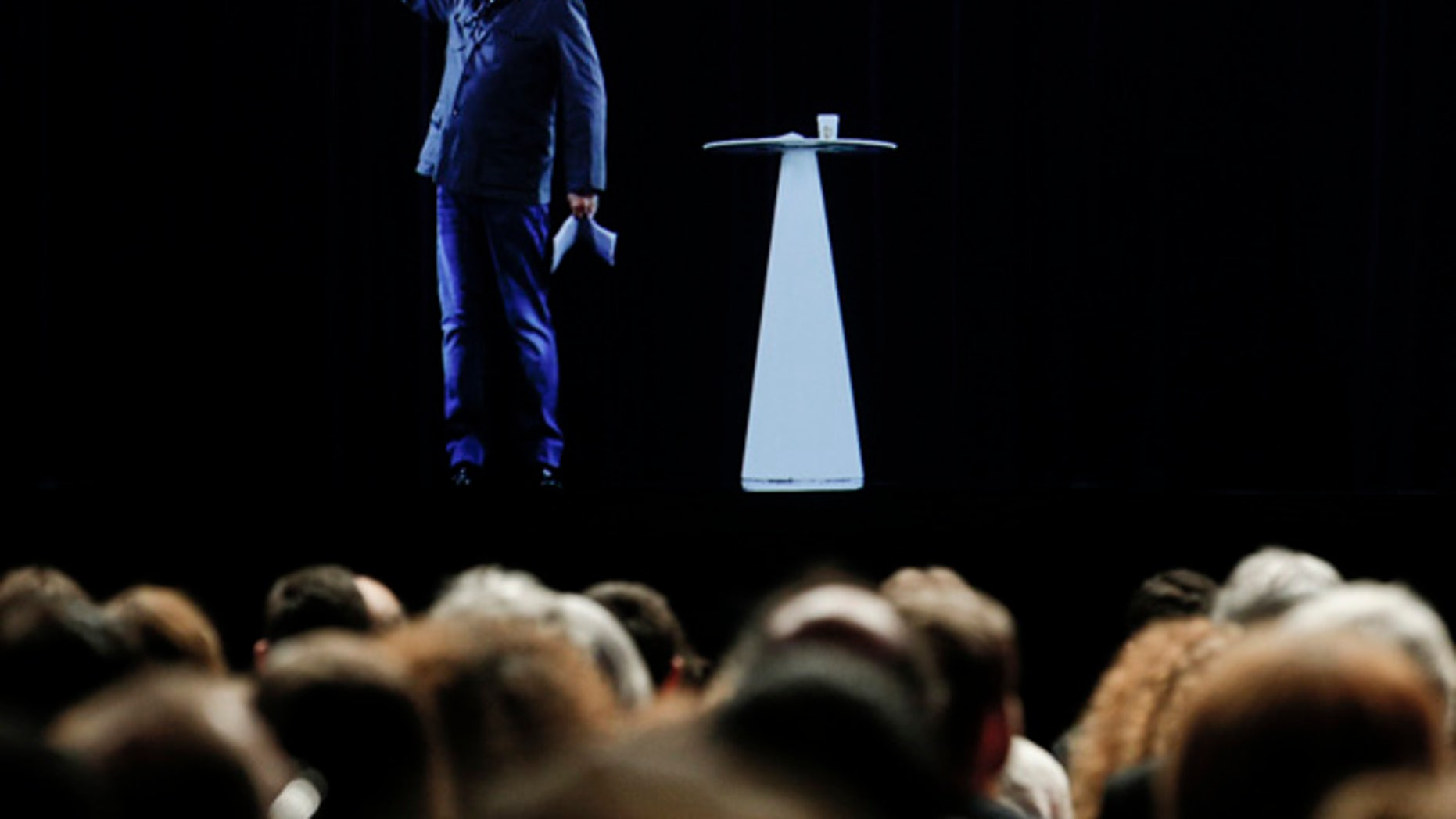 The hologram of hard-left French presidential candidate Jean-Luc Melenchon speaks to supporters who are gathered in Saint-Denis, near Paris.