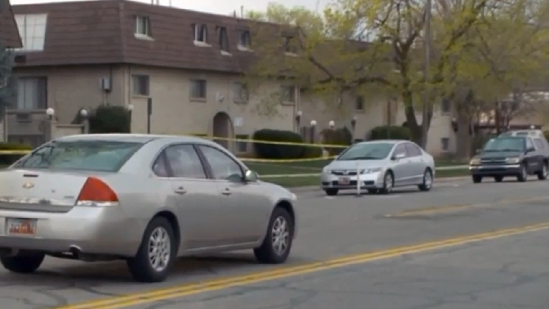 Police say a resident inside these Salt Lake City apartments shot and killed an intruder.