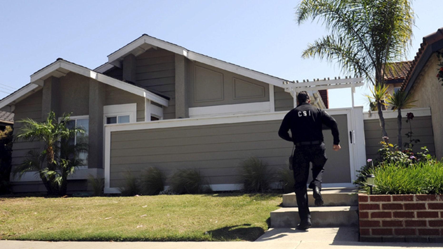 FILE: A Huntington Beach police Crime Scene Investigator is shown at the family home of Denise Huskins in Huntington Beach, California