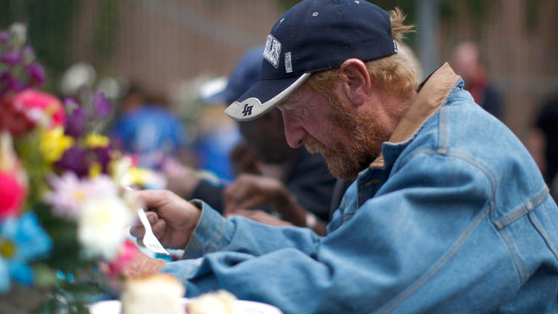 April 18, 2014: A man receives a meal at an event to help the homeless and near-homeless of Skid Row.