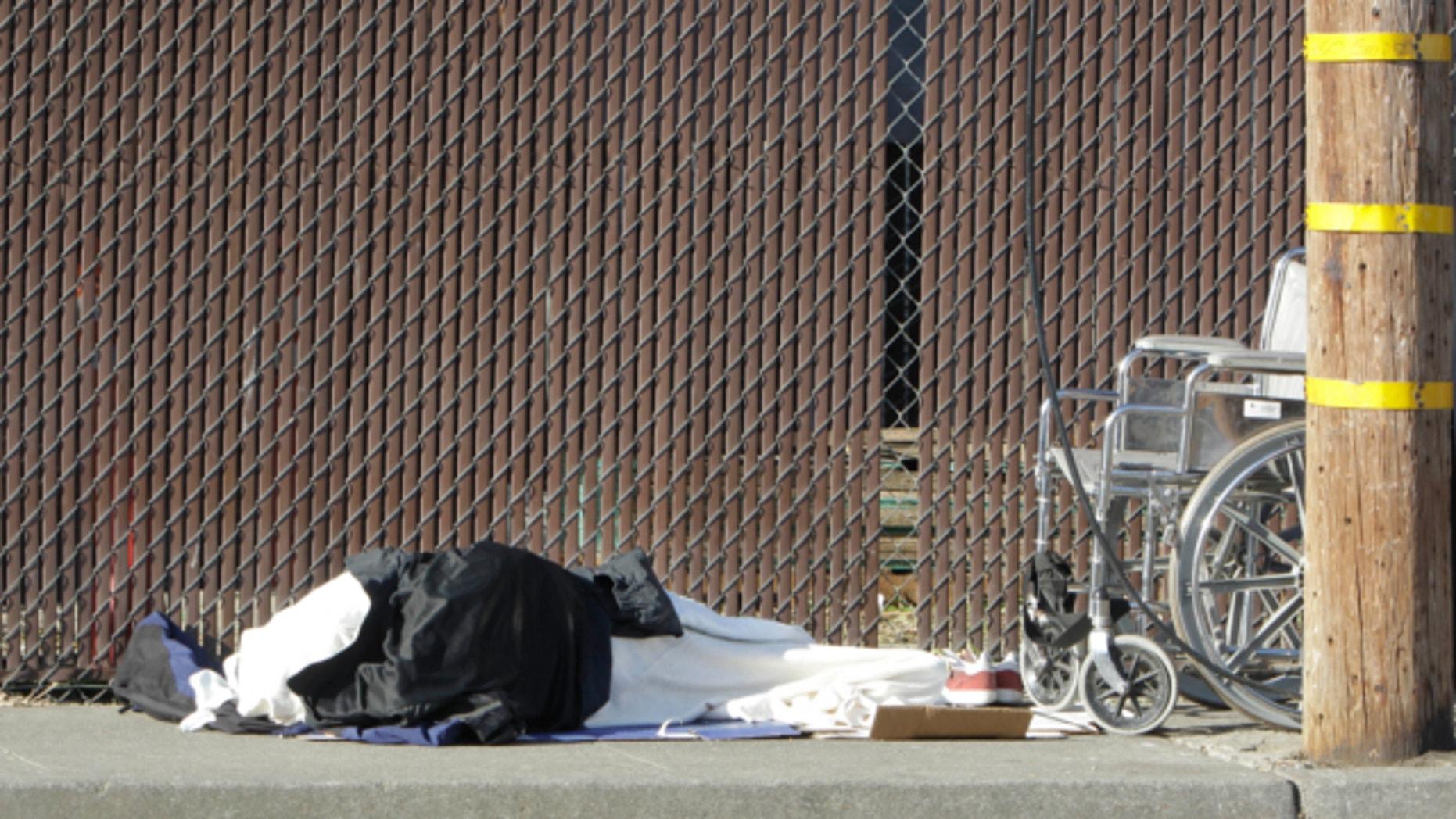 April 23, 2013: A homeless person sleeps on a sidewalk in Sacramento, Calif.