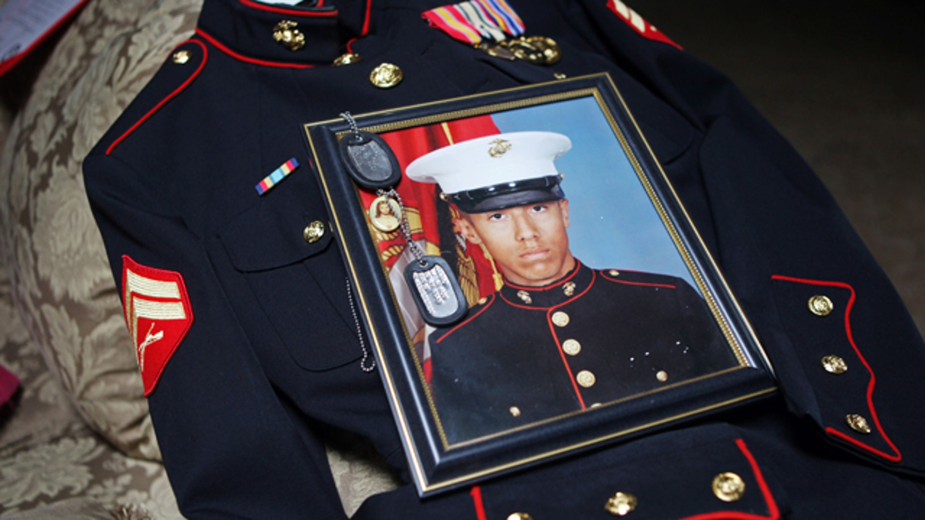 Jan. 15: Itzcoatl Ocampo's dress uniform, government military photo, dog tags and a religious medallion that went to war with him lie on display at Ocampo's home in Yorba Linda, Calif.