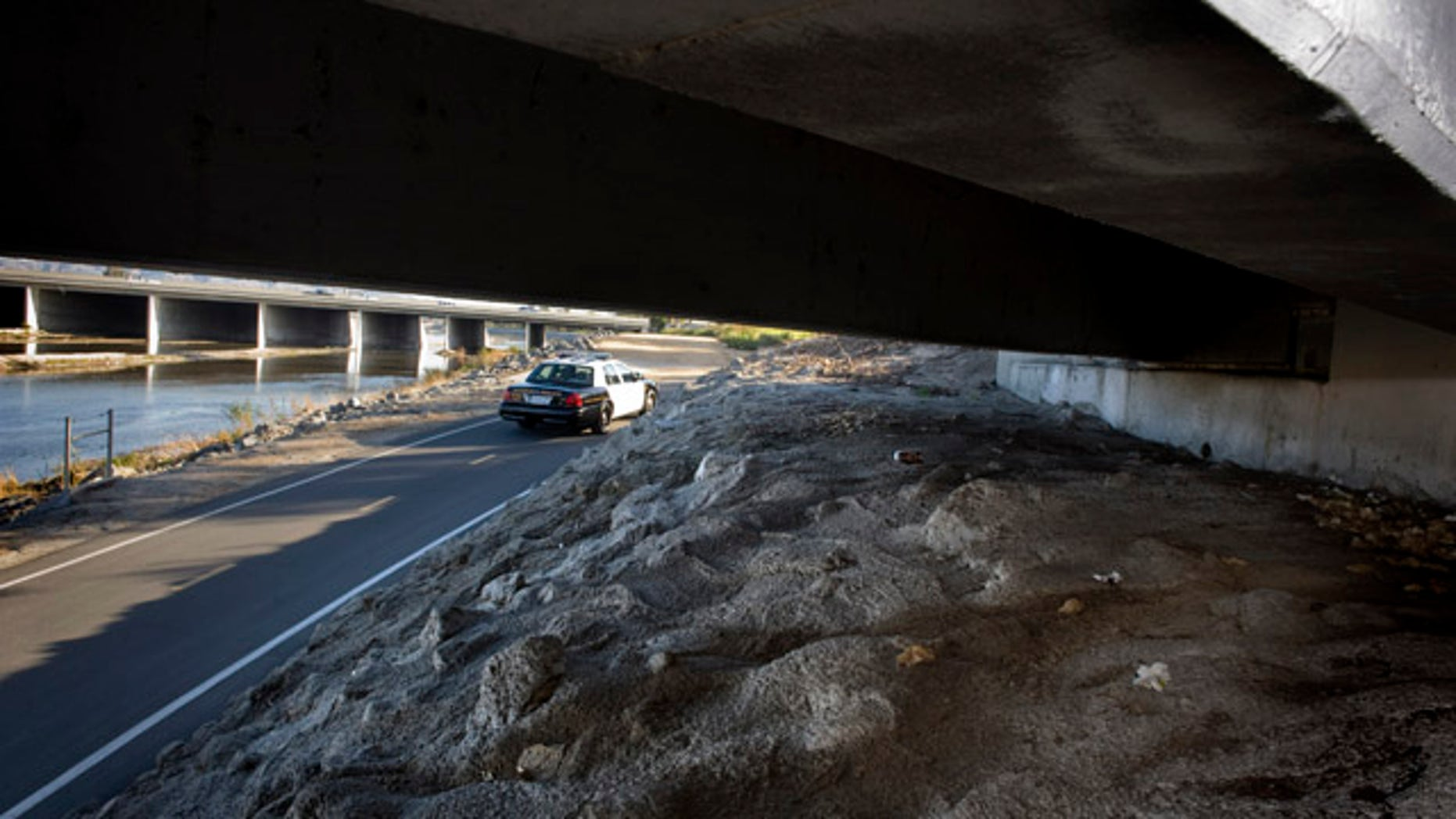 Jan. 3, 2012: A number of personal belongings lay under the Tustin Avenue bridge on the Santa Ana River Trail in Anaheim, Calif., just a few 100 yards to the west of the fatal stabbing of transient Lloyd Middaugh, 42.  Anaheim Police Chief John Welter told a news conference Wednesday, Jan. 4, 2012 that last month's slayings of three homeless men were likely the work of a serial killer. Authorities believe one person is responsible for the stabbing deaths, which occurred between Dec. 20 and Dec. 30, Welter said. In each case, a middle-aged man was targeted.