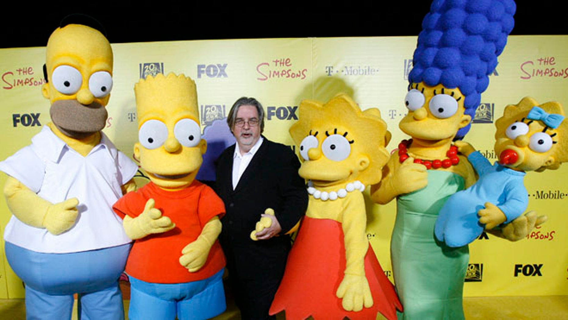 Oct. 18, 2009: Matt Groening (C), creator of The Simpsons, poses with characters from the show (L-R) Homer, Bart, Lisa, Marge and Maggie at the 20th anniversary party for the television series at Barker hangar in Santa Monica, California. (Reuters)