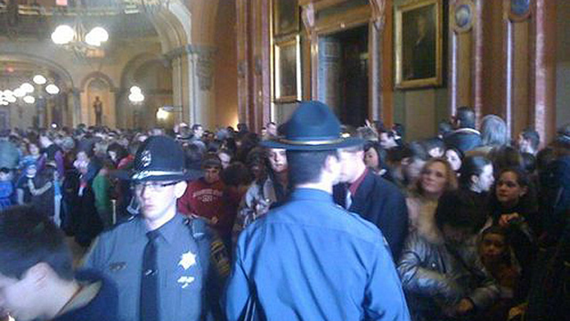 Thousands of people flooded the Illinois capital building in Springfield on Tuesday for an initial hearing for the bill, which has since been tabled. (IllinoisReview.com)