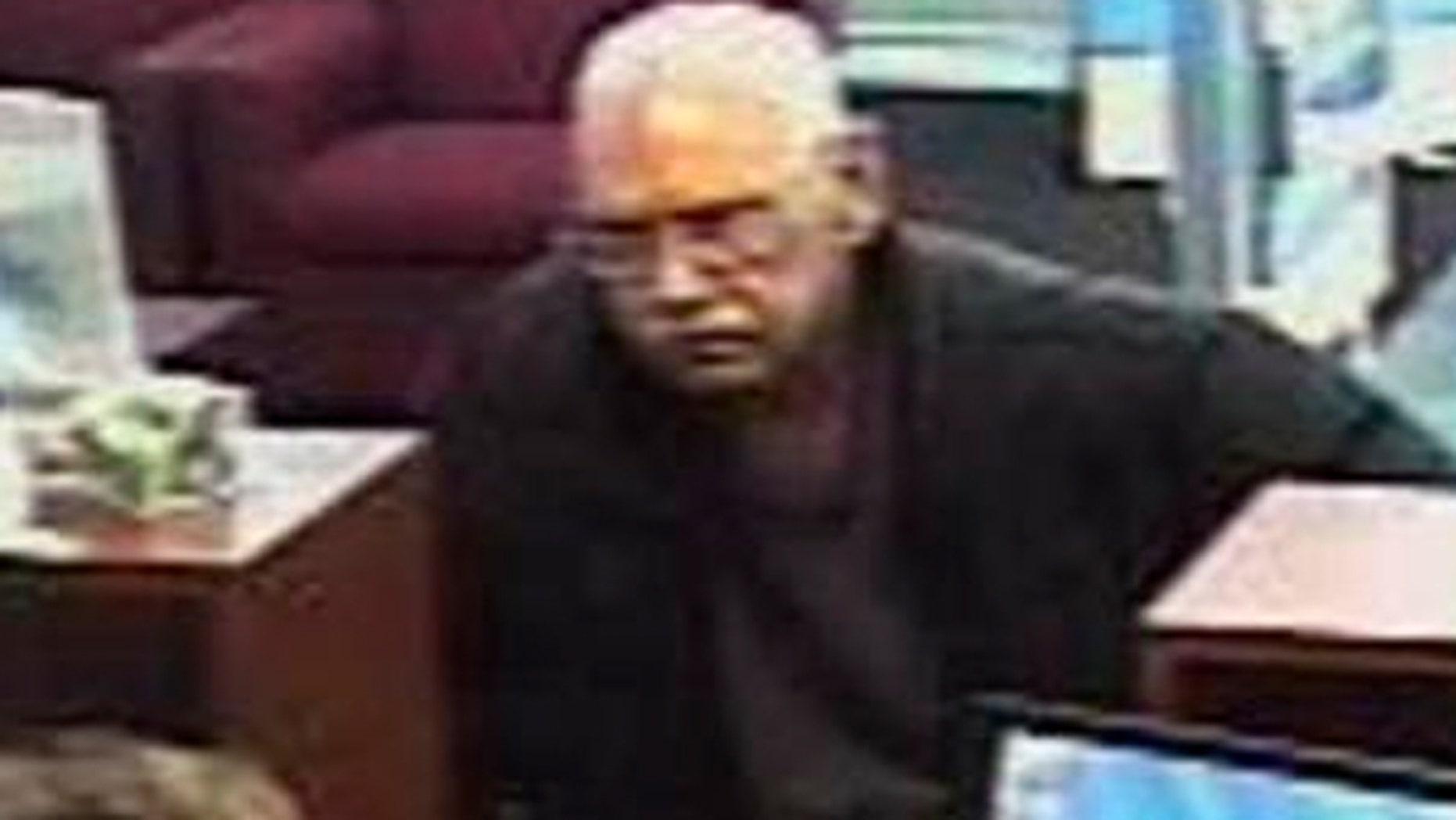 FILE: Surveillance photo provided by the FBI shows 73-year-old Walter Unbehaun, an ex-convict from Rock Hill., S.C., during a bank robbery in Niles, Ill. Unbehaun allegedly told investigators he intended to get caught so he could live his final years behind bars.