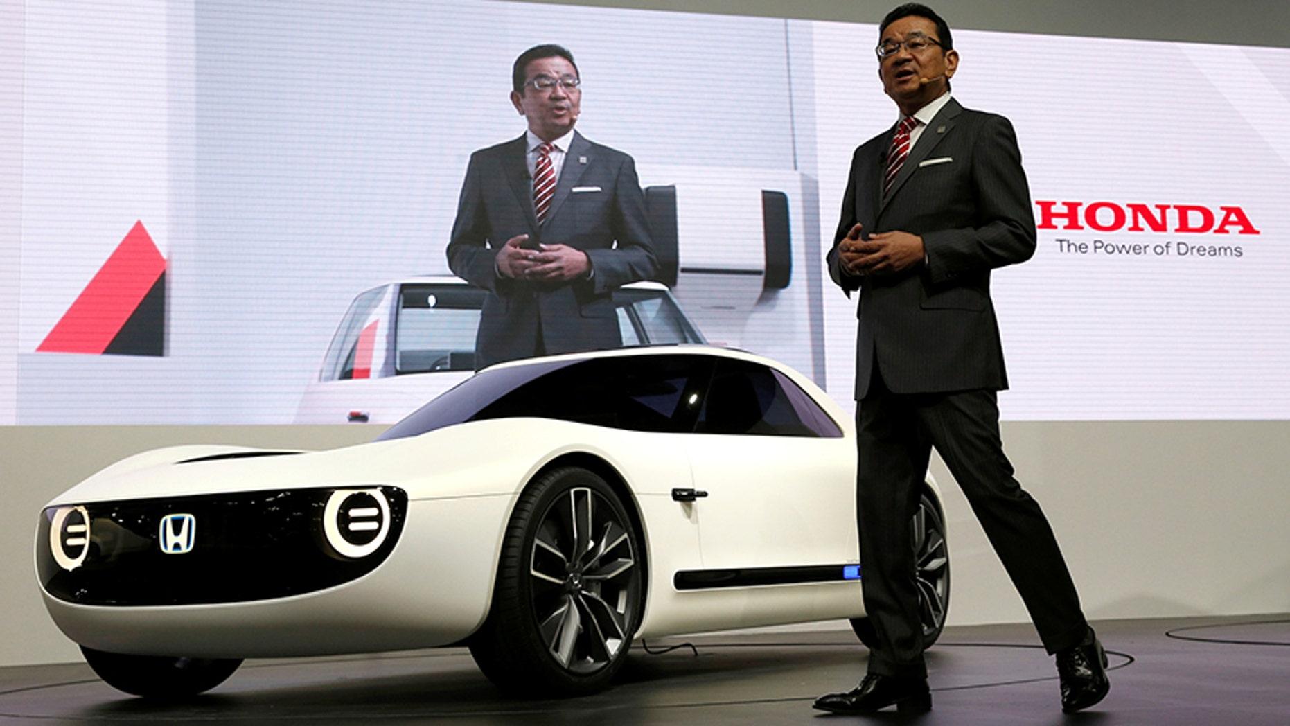 Honda CEO Takahiro Hachigo unveiling the Sports EV at the Tokyo Motor Show