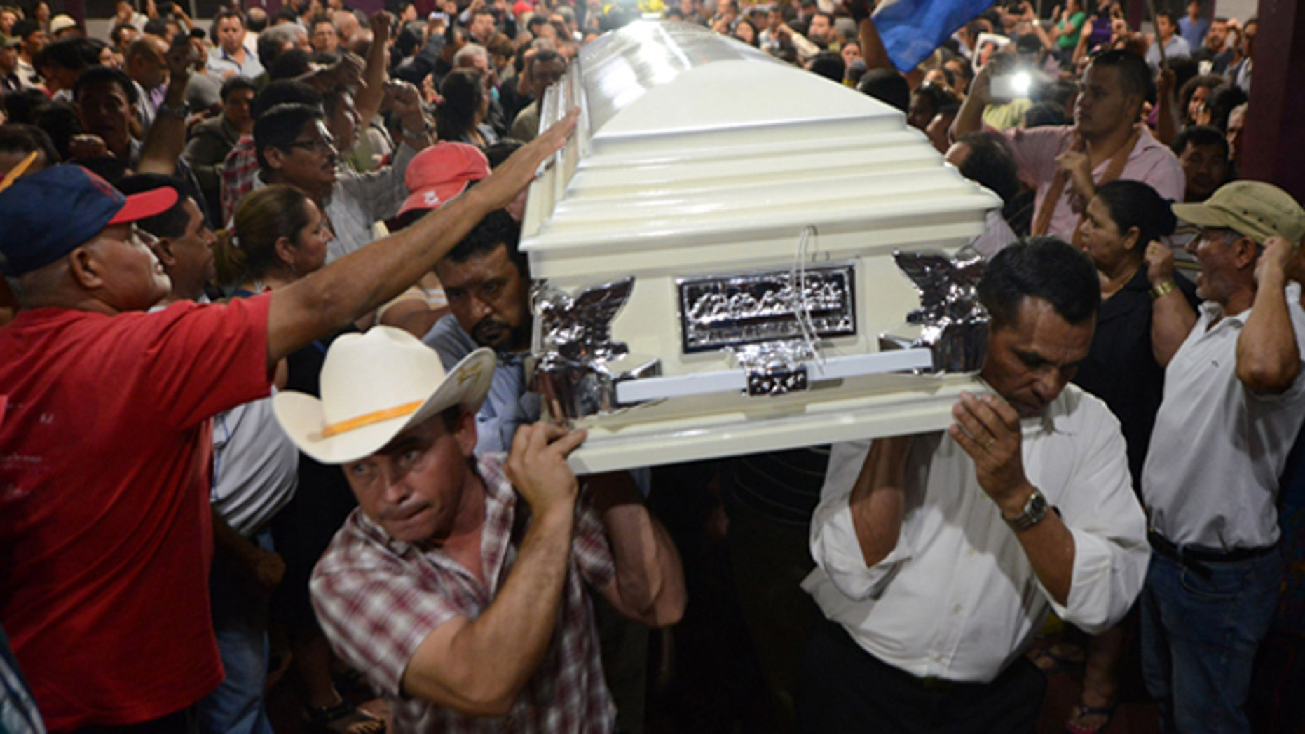 Relatives and friends carry the coffin of murdered indigenous activist Berta Caceres during her funeral in La Esperanza, 200 km northwest of Tegucigalpa, on March 3, 2016. Caceres, a respected environmentalist who won the prestigious Goldman Prize last year for her outspoken advocacy, was murdered in her home Thursday, her family said. AFP PHOTO /ORLANDO SIERRA / AFP / ORLANDO SIERRA        (Photo credit should read ORLANDO SIERRA/AFP/Getty Images)