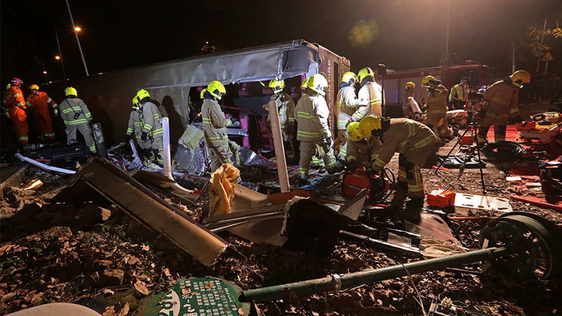 Firemen work at the scene of a bus crash in Hong Kong, Saturday, that killed 18 people.