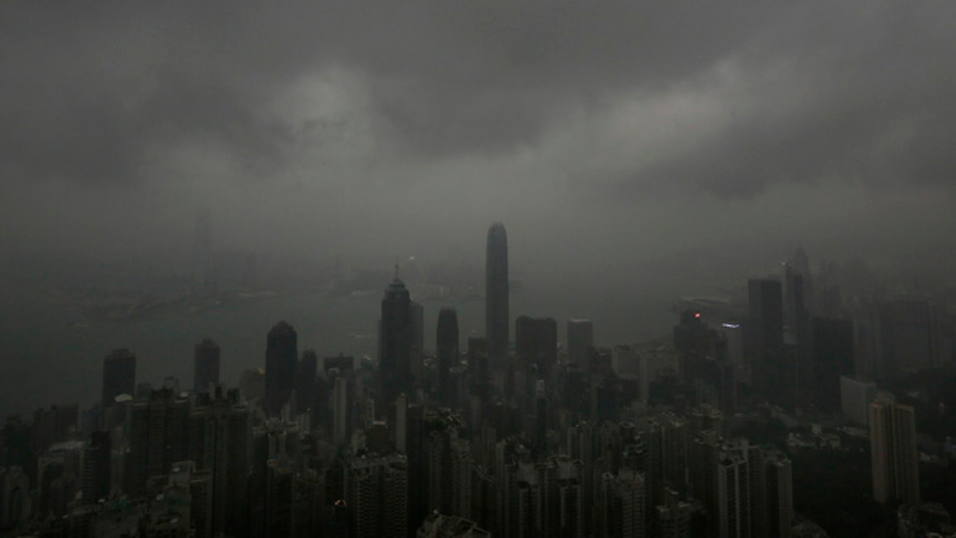 Sept. 22, 2013: Dark clouds hang low over Hong Kong's Victoria Habour. Usagi, the year's most powerful typhoon had Hong Kong in its cross-hair on Sunday after sweeping past the Philippines and Taiwan and pummeling island communities with heavy rains and fierce winds. The typhoon was grinding westward and expected to make landfall close to Hong Kong late Sunday or early Monday.
