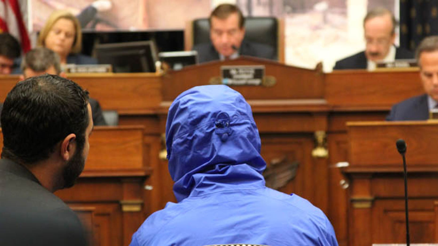July 31, 2014: A Syrian defector who goes only by the name 'Caesar,' and who wore a hood to obscure his face, testifies before the House Foreign Affairs Committee.