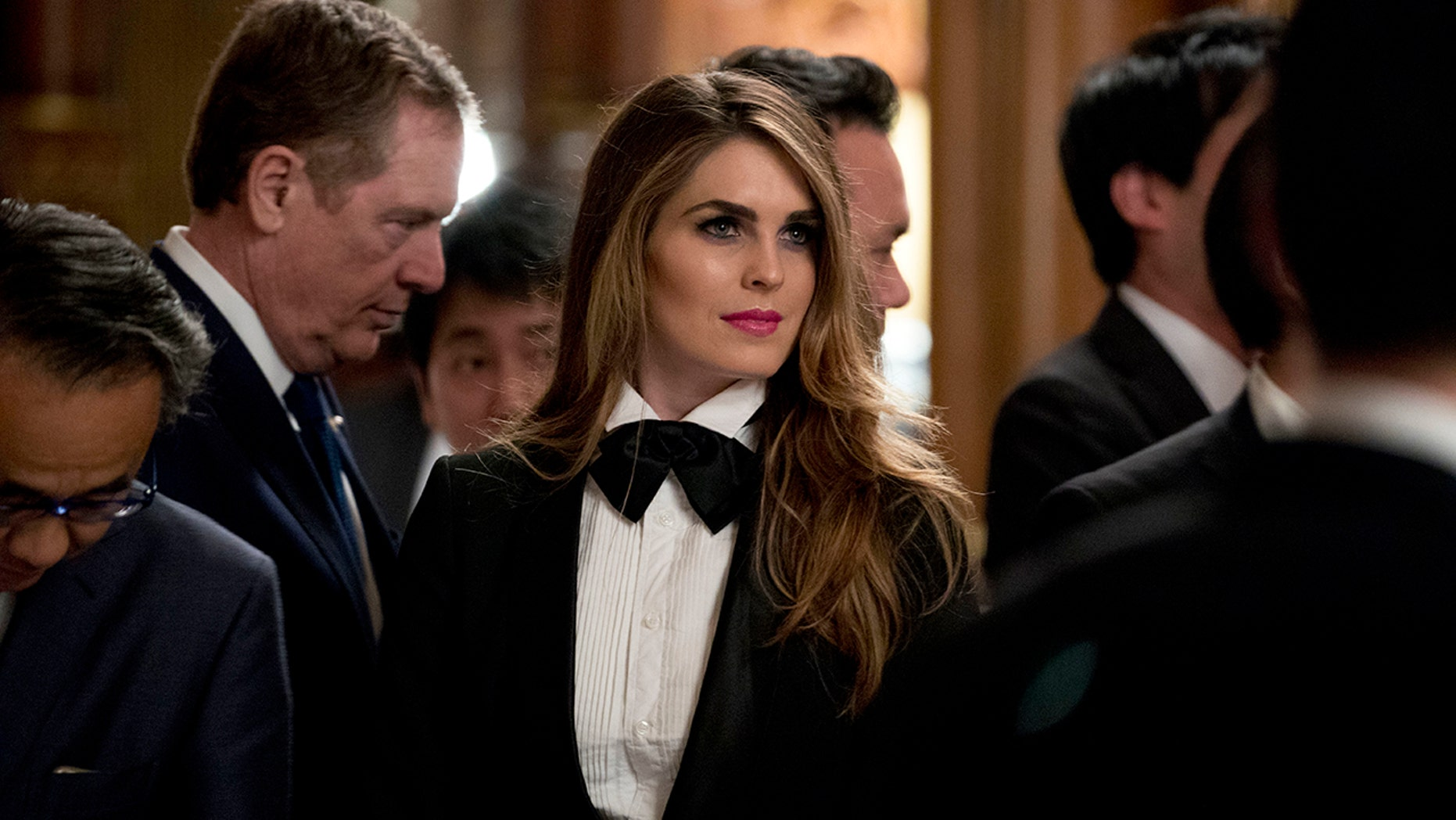Hope Hicks stunned in a toned down tuxedo at Monday night's state dinner in Japan.