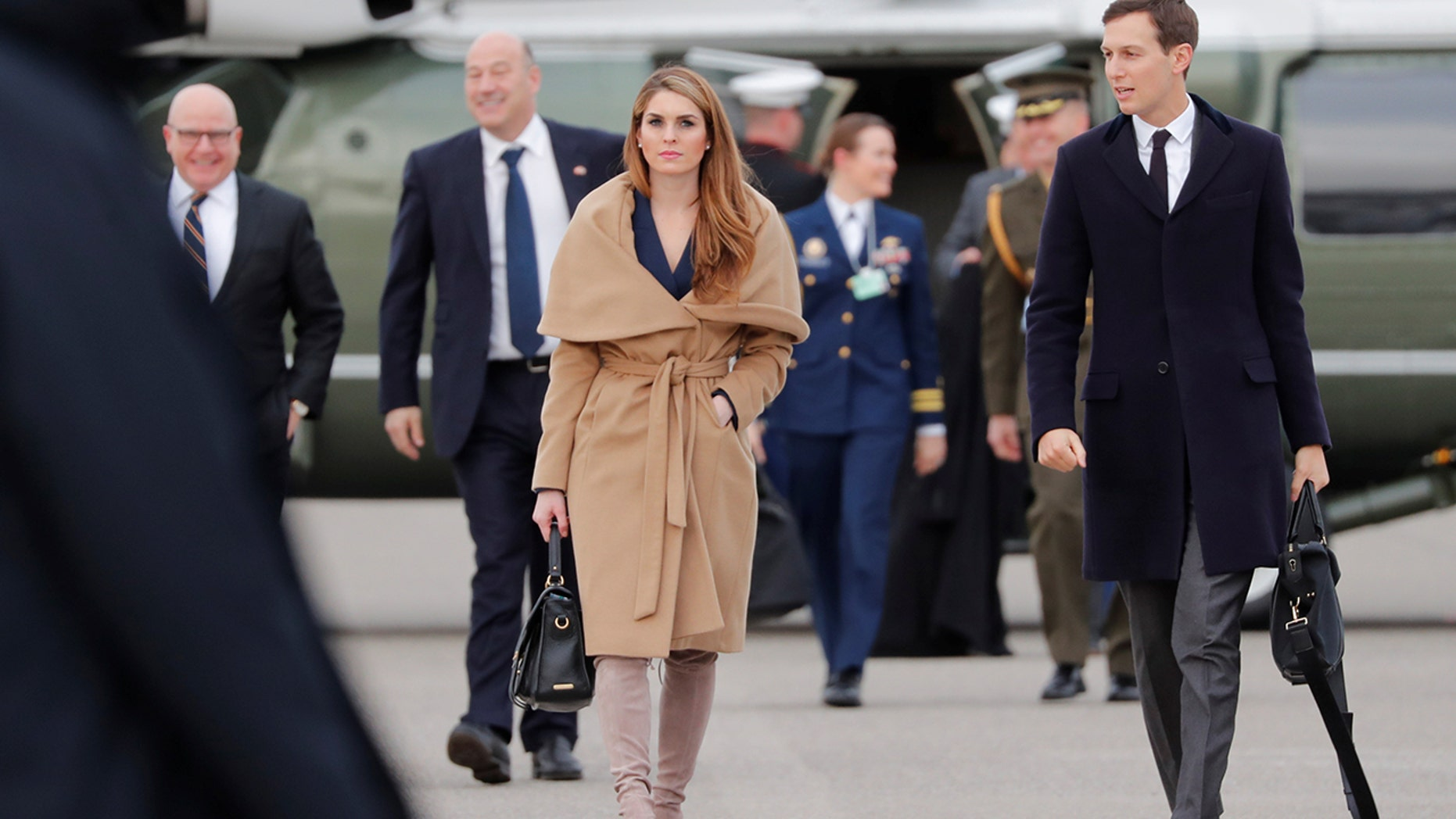The White House communications director stunned in a pair of taupe suede, thigh-high Stuart Weitzman boots, priced at $798, and a navy blue wrap dress.