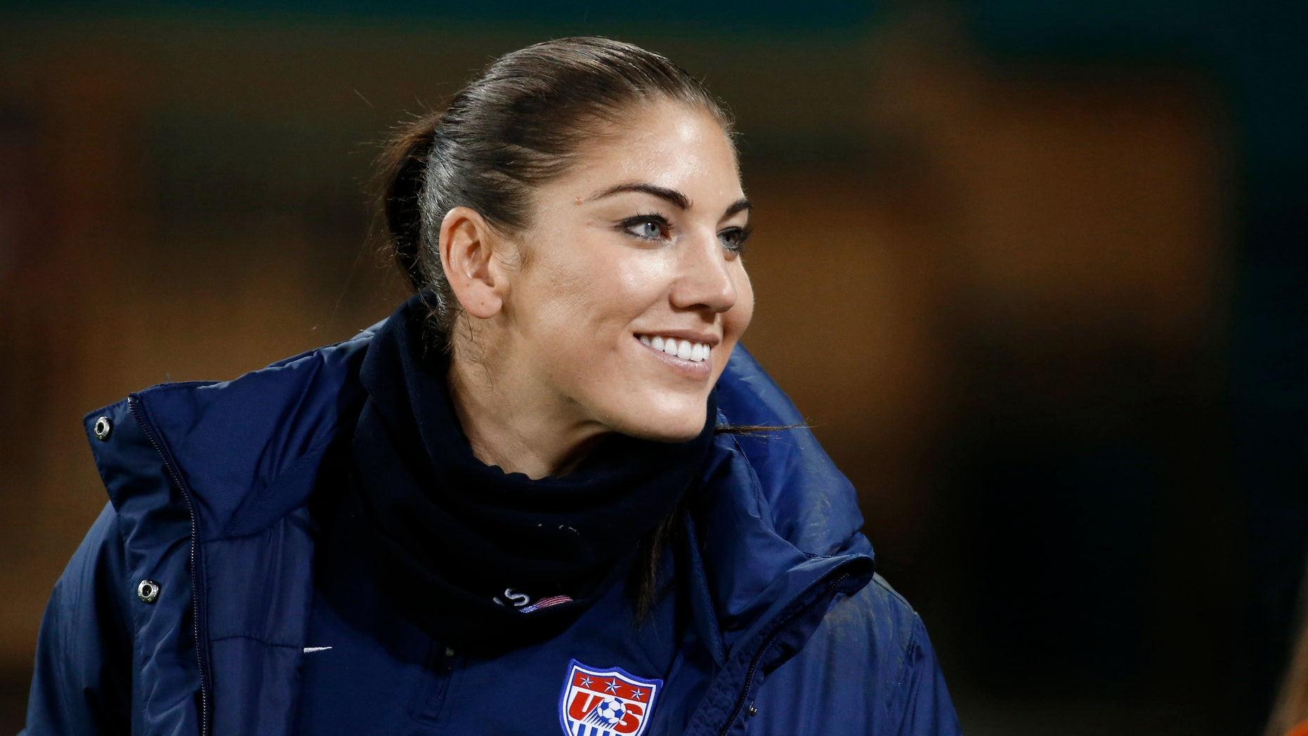 Oct. 20, 2014:  U.S. goalkeeper Hope Solo stands on the sidelines before a CONCACAF soccer match against Haiti in Washington.