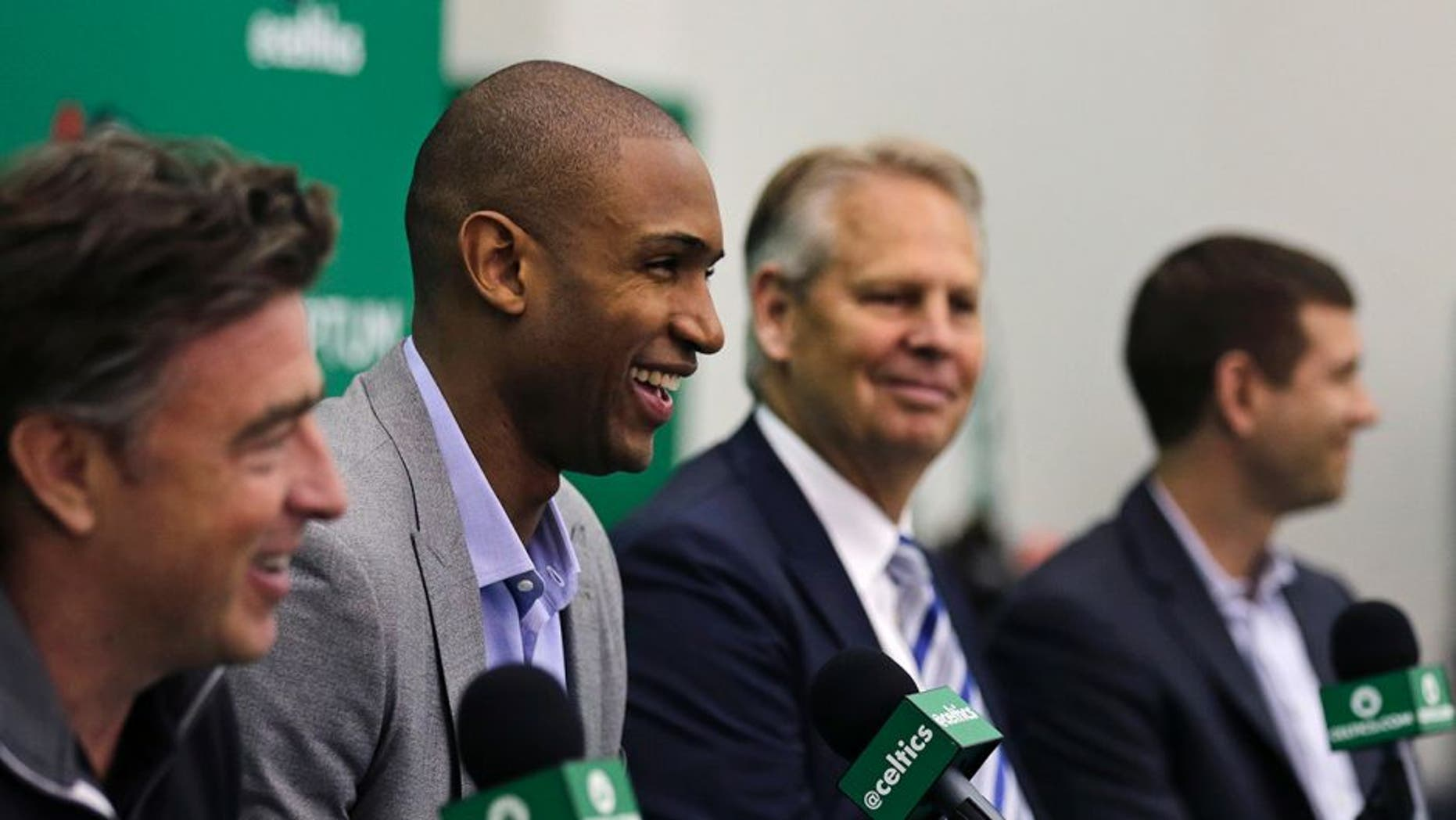 Boston Celtics forward Al Horford, second from left, smiles during a media availability at the team's practice facility, Friday, July 8, 2016, in Waltham, Mass. Horford agreed to a four-year, $113 million deal with the Celtics as an unrestricted free agent, ending nearly ten years with the Atlanta Hawks. From left are Celtics owner Wyc Grousbeck, Horford, general manager Danny Ainge and head coach Brad Stevens. (AP Photo/Charles Krupa)