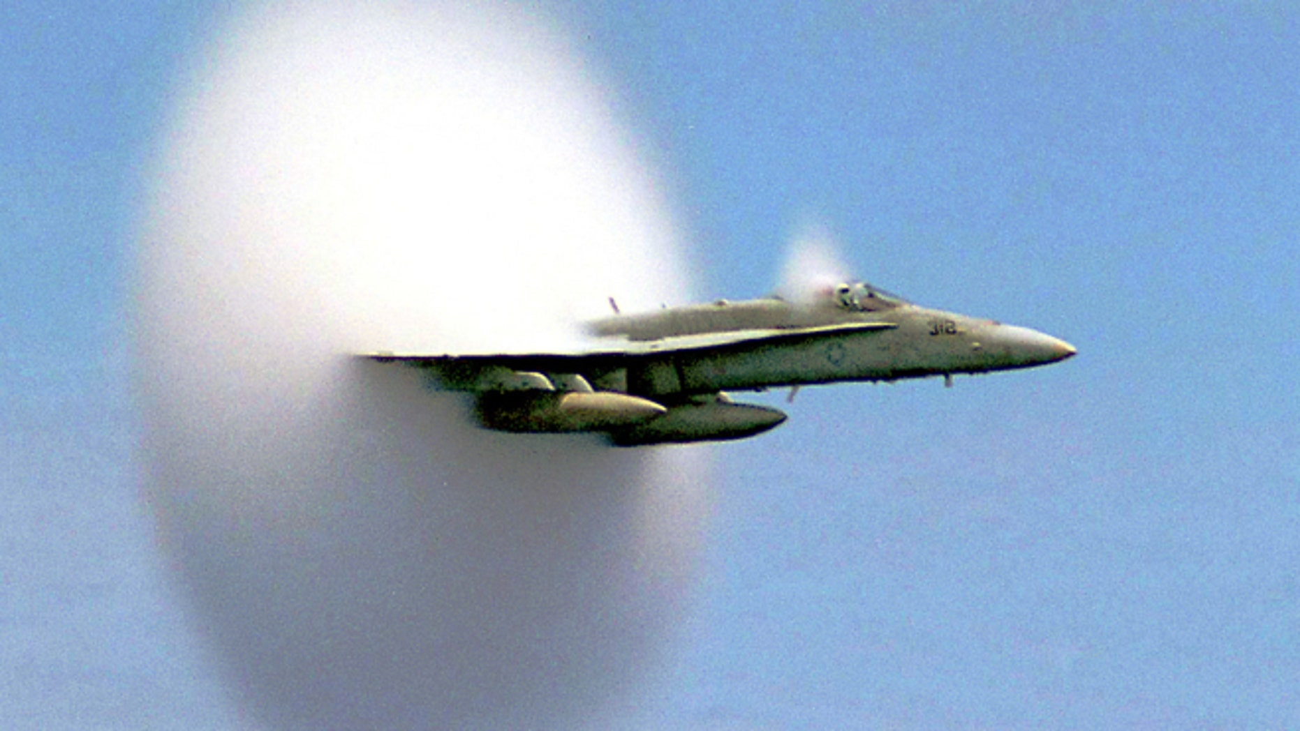 FILE: An F/A-18 Hornet breaks the sound barrier. The sonic booms have been known to shake buildings.