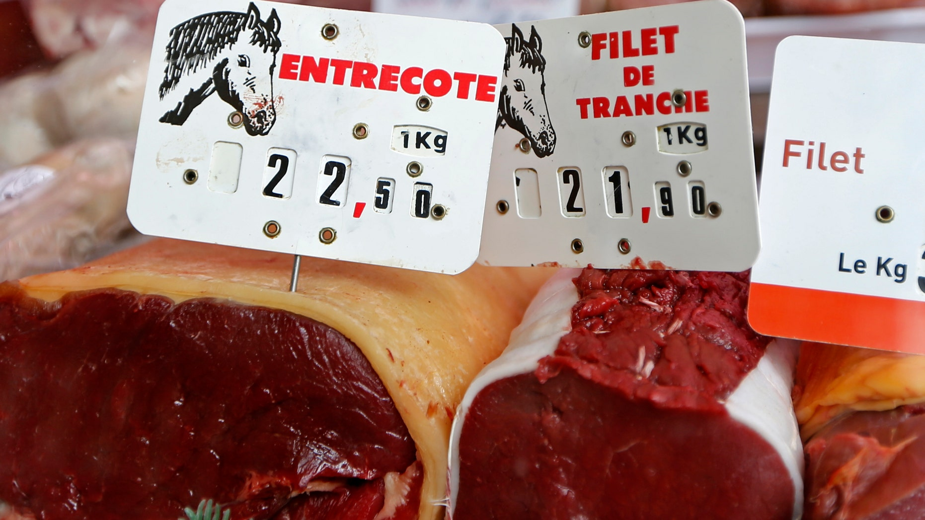 Cuts of horsemeat are displayed in a shop window at the horse butchery near Paris.