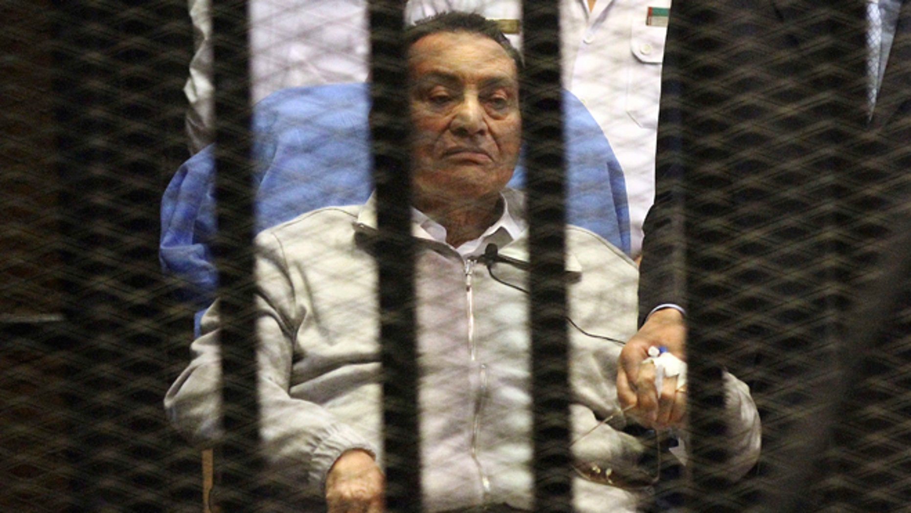 April 15, 2013: Egypt's ousted President Hosni Mubarak sits inside a dock at the police academy on the outskirts of Cairo.