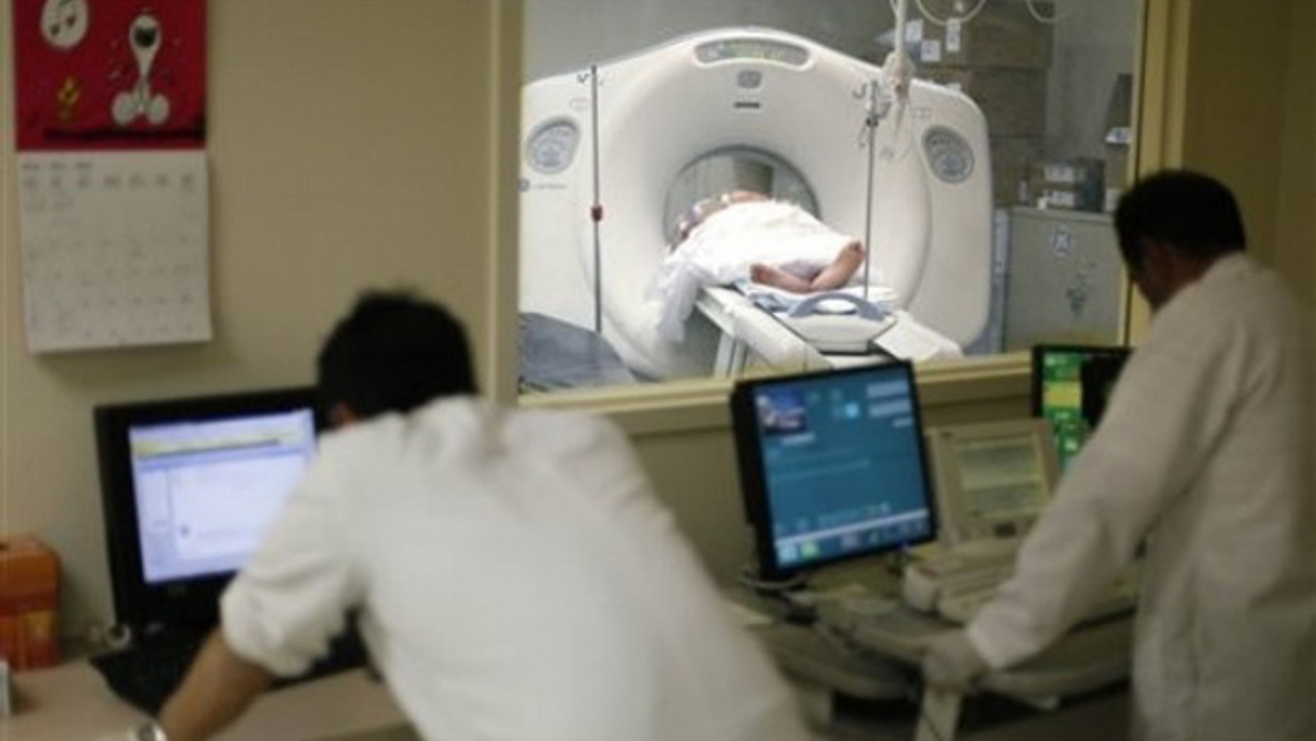 In this May 4 photo, a CT is performed on a patient at Cook County Stroger Hospital in Chicago.