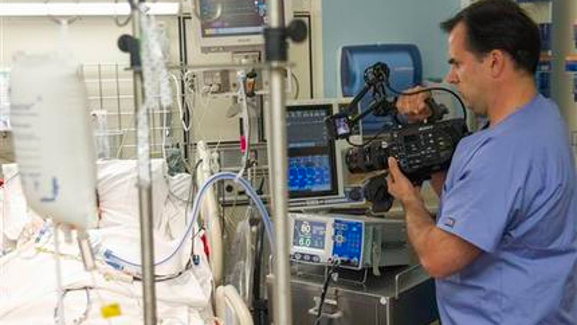 Feb. 23, 2015: In this photo, Dr. Angelo Volandes films a patient at Straub Clinic and Hospital in Honolulu, for videos he develops that educate families about end-of-life care options, such as CPR.