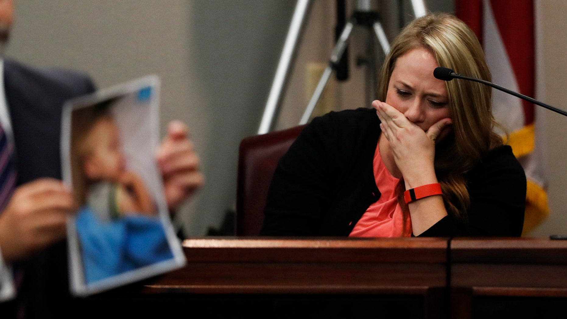 Leanna Taylor cries as an attorney shows photographs of her son Cooper to the jury during a murder trial for her ex-husband Justin Ross Harris Monday, Oct. 31, 2016, in Brunswick, Ga.
