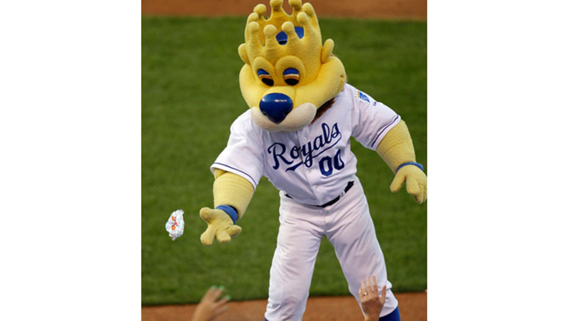 """FILE 2009: Kansas City Royals mascot """"Sluggerrr"""" throws hot dogs into the crowd during a baseball game against the Cleveland Indians in Kansas City, Mo."""