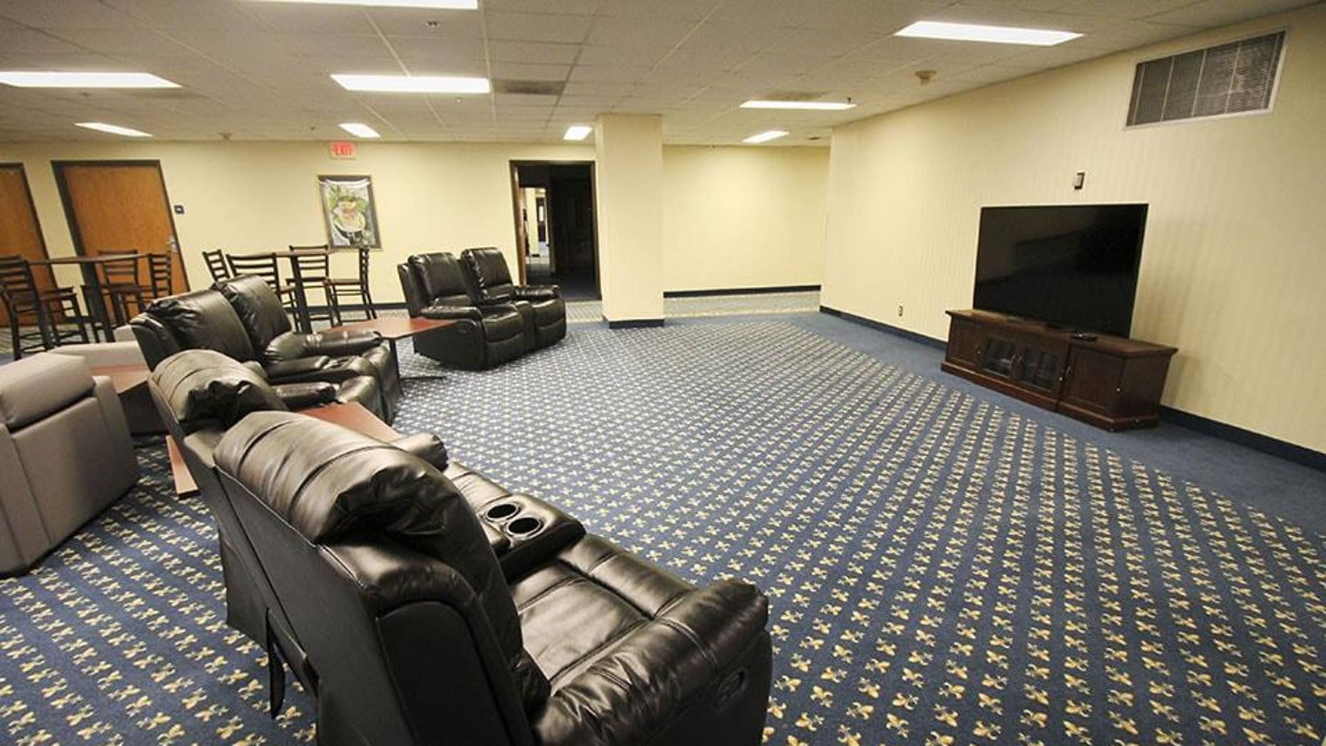 """""""Hotel Influenza"""" features private hotel-like rooms with television and internet, as well as common areas where volunteers can socialize."""