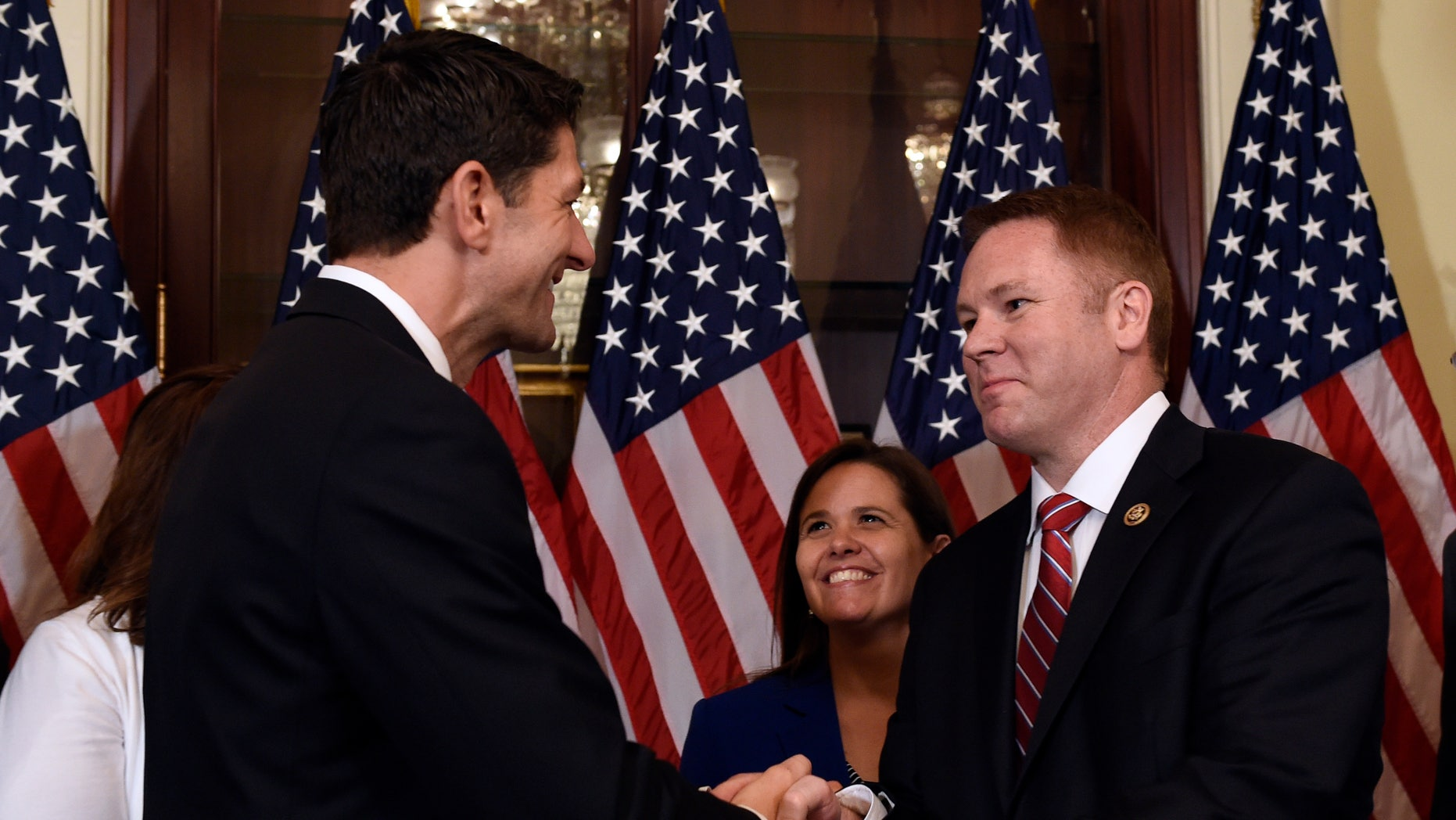 June 9, 2016: House Speaker Paul Ryan of Wis., left, shakes hands with Rep.-elect Warren Davidson, R-Ohio, right, before Davidson is officially sworn in on Capitol Hill in Washington.