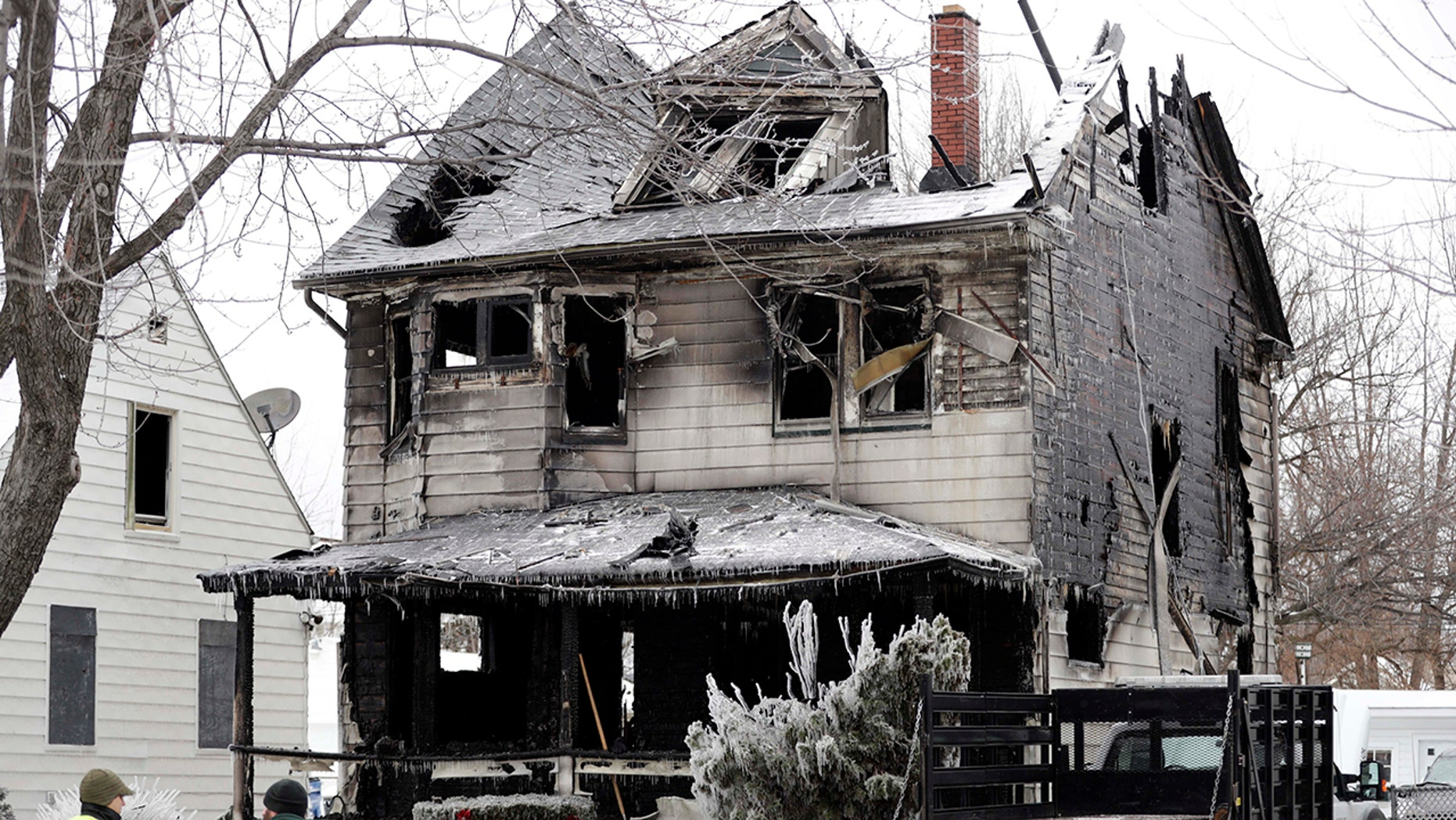 Four bodies were found at the site of a house fire, Tuesday, Jan. 30, 2018, in Cleveland.