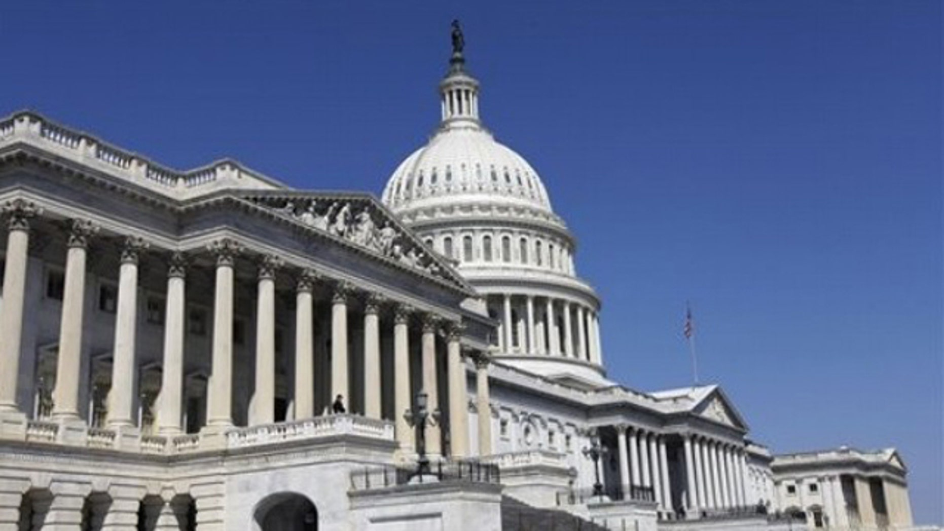 The US Capitol is seen in Washington, Wednesday, April 6, 2011, with the House of Representatives in the foreground, as Congress debates the budget. (AP Photo/Alex Brandon)