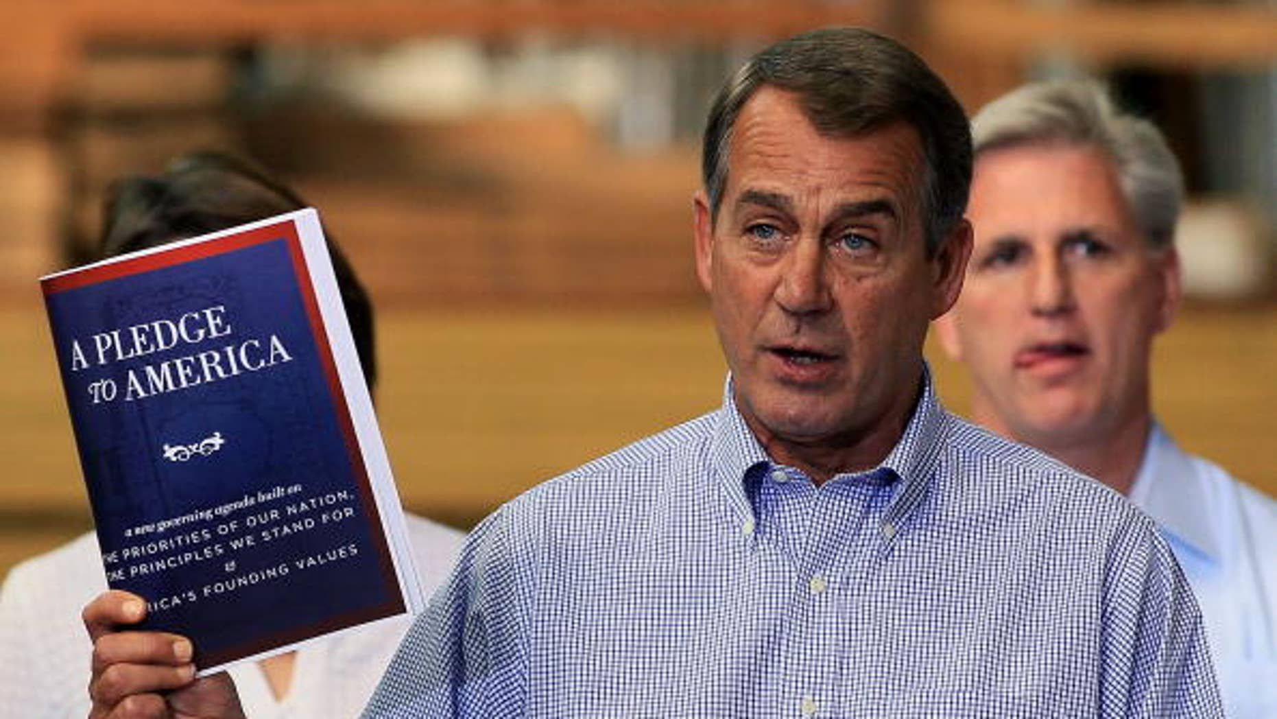 "STERLING, VA - SEPTEMBER 23:  House Minority Leader John Boehner (R-OH), holds a copy of  ""A Pledge To America"" plan while flanked by members of Congress and small business owners during an event at the Tart Lumber on September 23, 2010 in Sterling, Virginia. House Republicans held their ""Pledge To America"" news conference at the family owned lumber store to unveil their proposed governing agenda for the upcoming 111th Congress.  (Photo by Mark Wilson/Getty Images)"