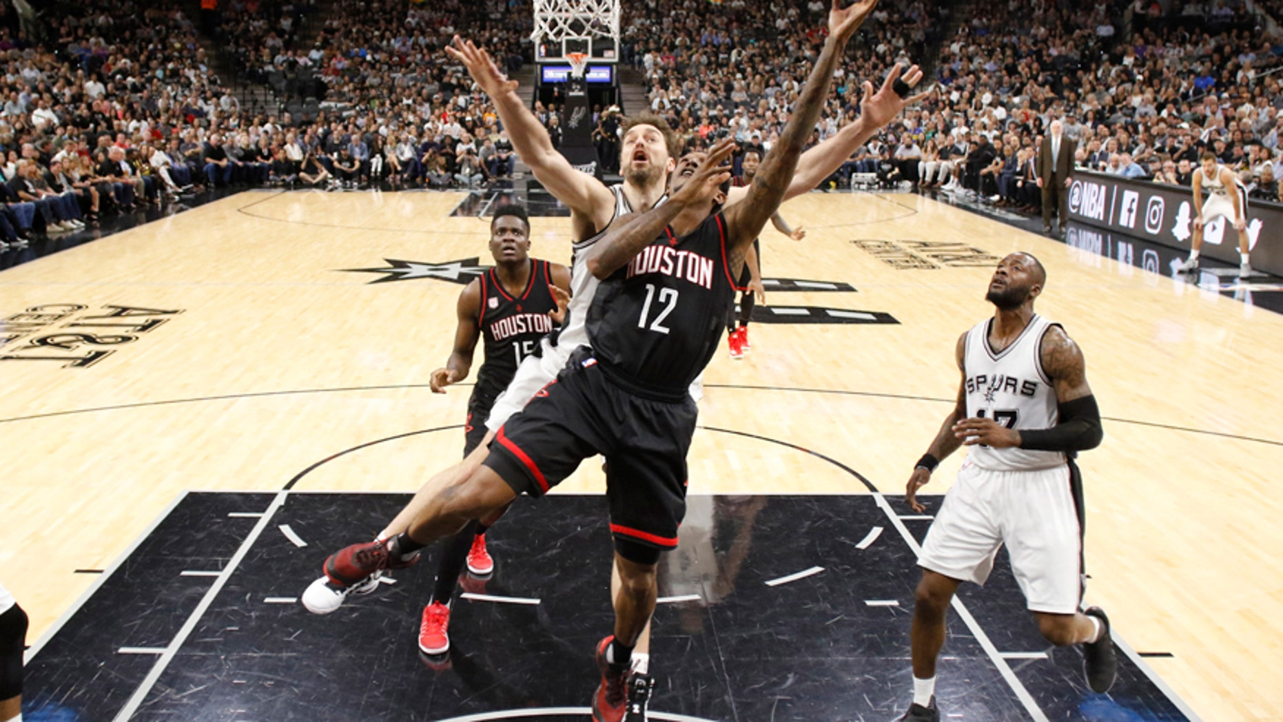 May 9, 2017; San Antonio, TX, USA; Houston Rockets shooting guard Lou Williams (12) shoots the ball past San Antonio Spurs center Pau Gasol (behind) during the first half in game five of the second round of the 2017 NBA Playoffs at AT&T Center.
