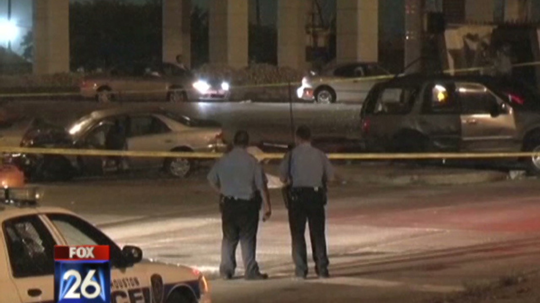Houston police survey the damage of a drunk driving crash that left three teenagers dead on July 9. (MyFoxHouston)
