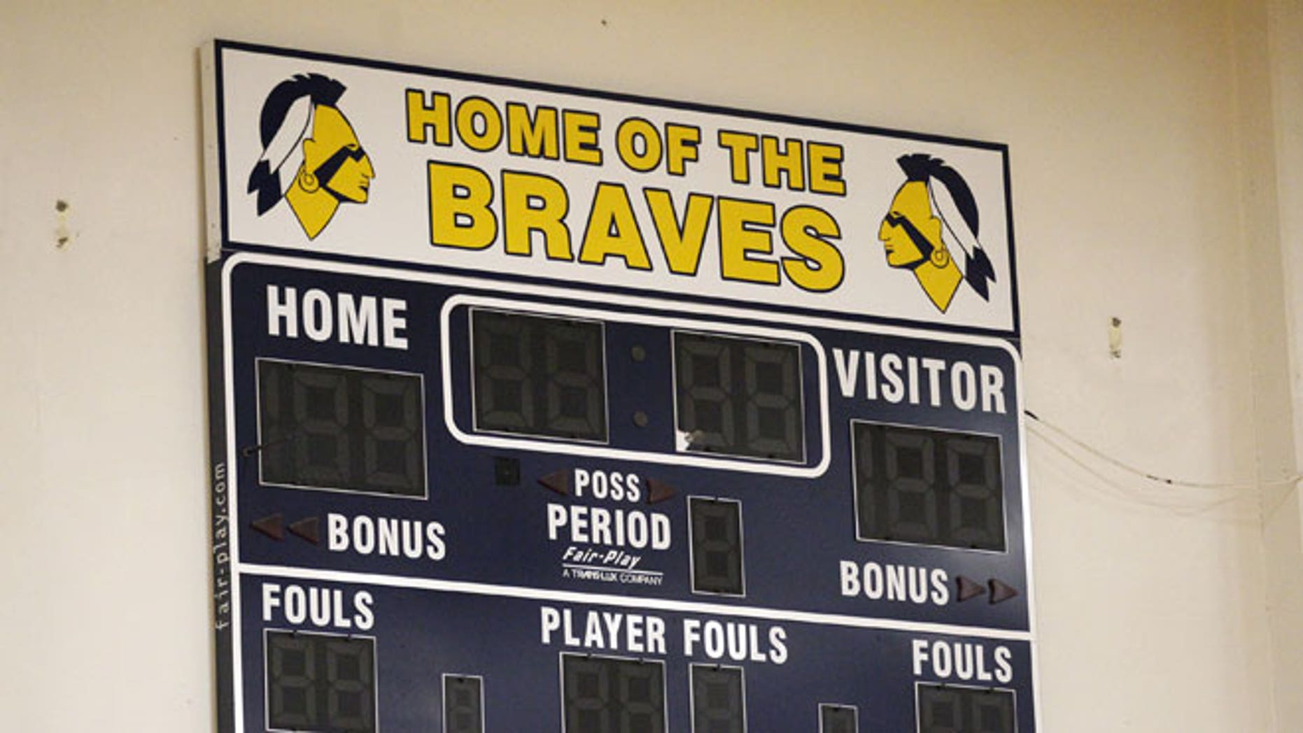 FILE: May 16, 2012: The Banks High School score board is shown on the wall of their gym in Banks, Oregon.