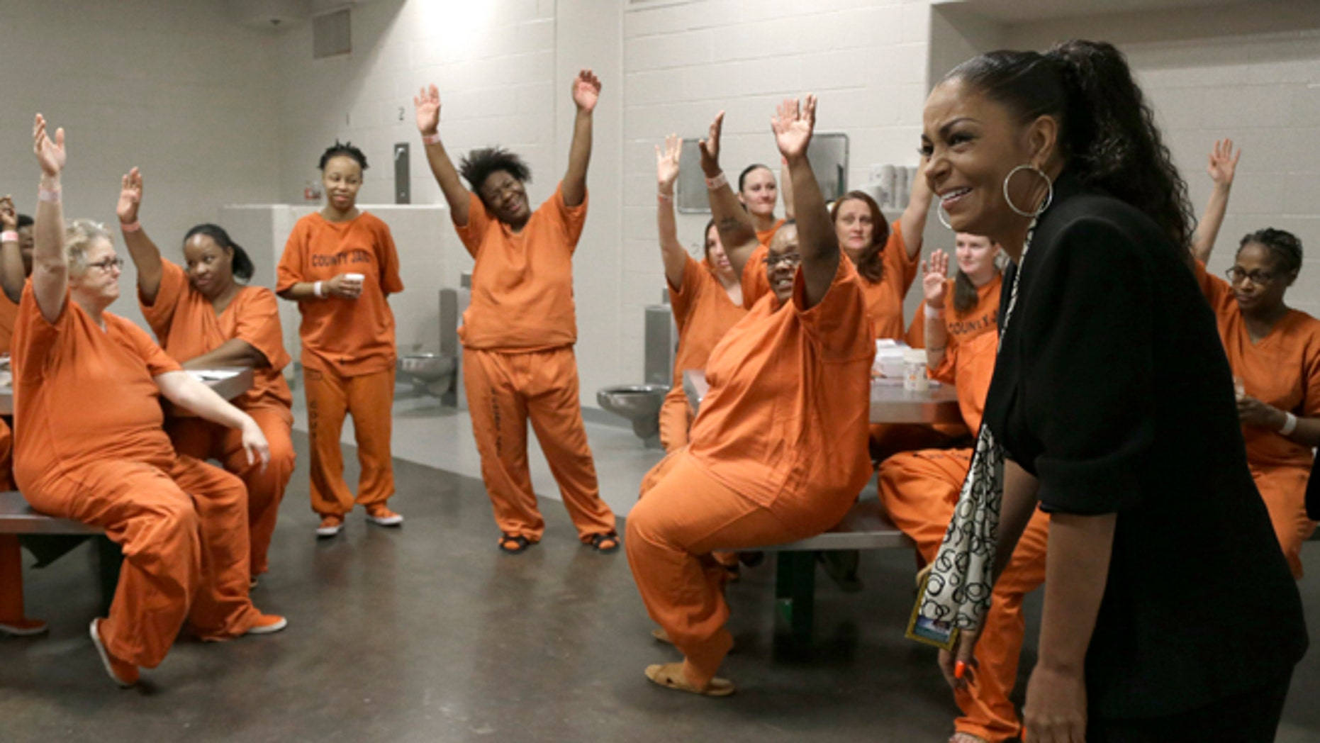 June 4, 2013: Kathryn Griffin Grinan, left, reacts as Harris County jail inmates sing her praises during a group session in Houston. Griffin started and runs prostitution rehabilitation program We've Been There Done That. (AP)