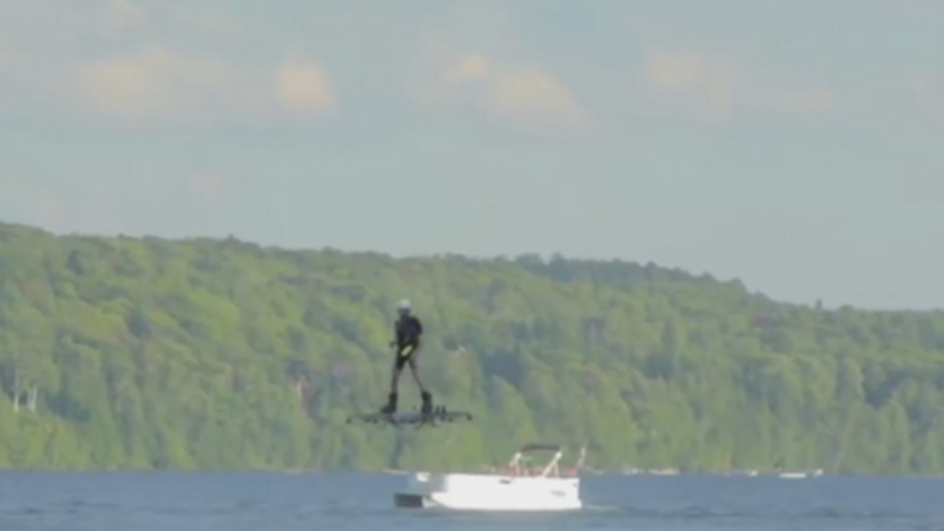 Catalin Alexandru Duru soars over a lake in Quebec, Canada in this screenshot of the Guinness World Records YouTube video.