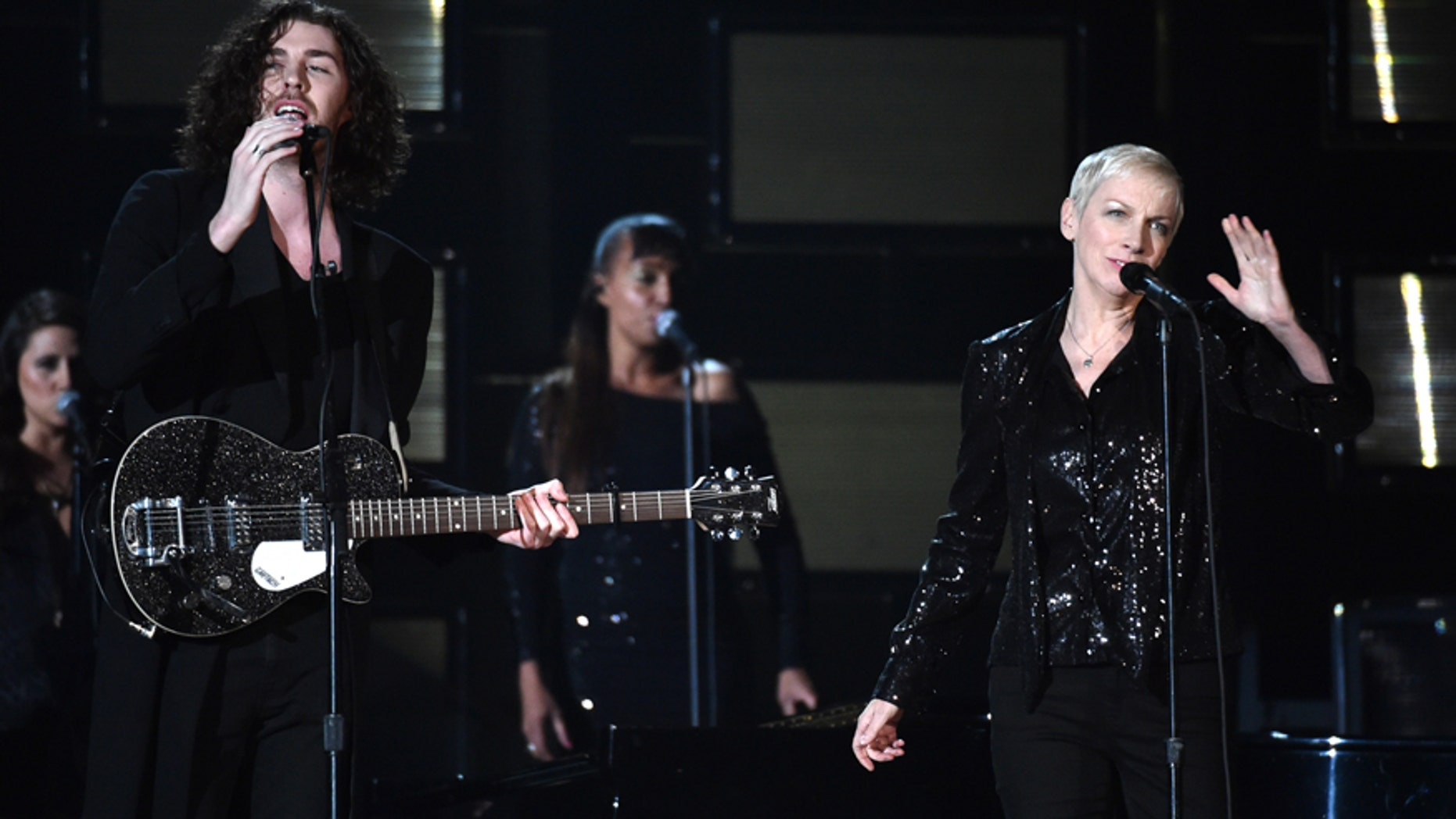 Hozier, left, and Annie Lennox perform at the 57th annual Grammy Awards on Sunday, Feb. 8, 2015, in Los Angeles.