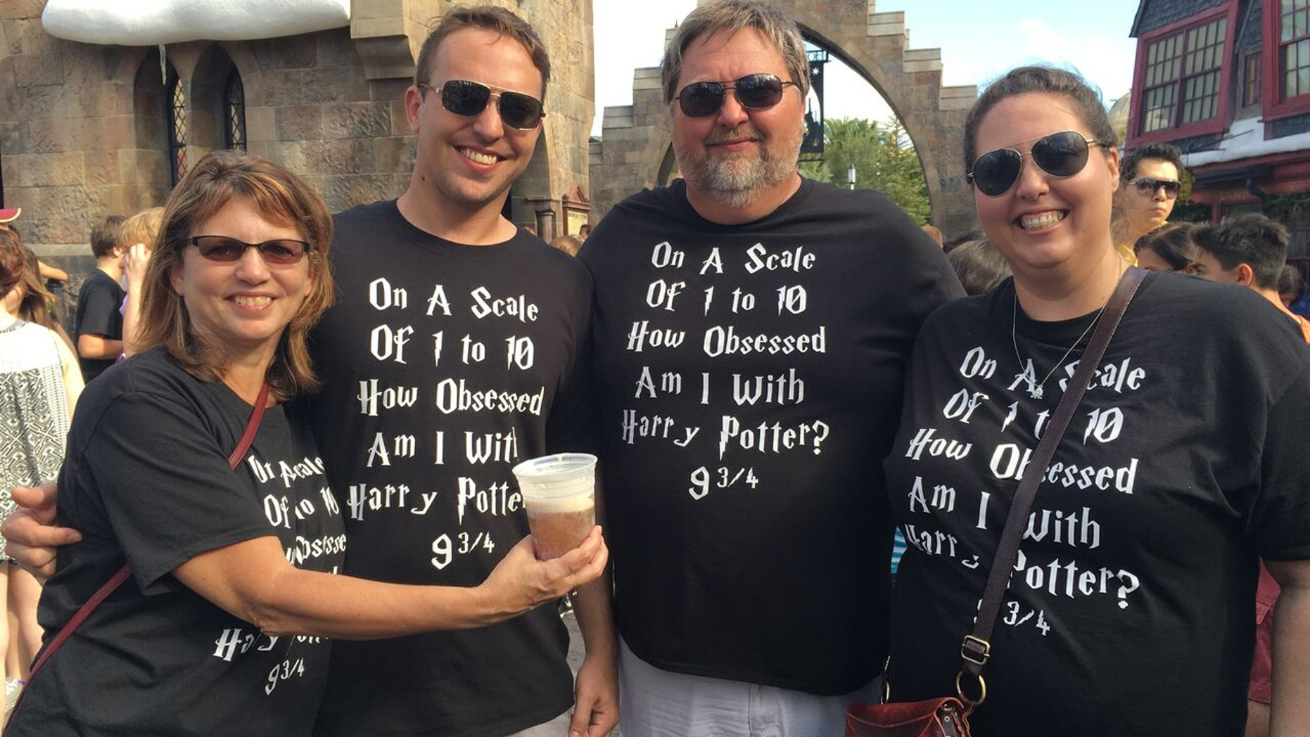 """The Bennett family are Harry Potter superfans and visit Universal Orlando  dressed in matching custom-made t-shirts that read, """"How obsessed am I with Harry Potter? 9 ¾."""""""