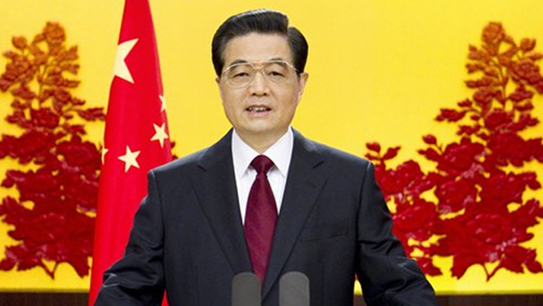 In this undated photo released on Dec. 31, 2010, by China's Xinhua News Agency, Chinese President Hu Jintao delivers a New Year address in Beijing.