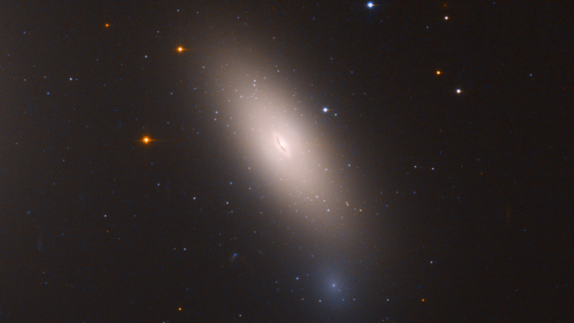 This Hubble Space Telescope image shows the galaxy NGC 1277, which is unique in that it is considered a relic of what galaxies were like in the early universe. NGC 1277 is composed exclusively of aging stars that were born 10 billion years ago.