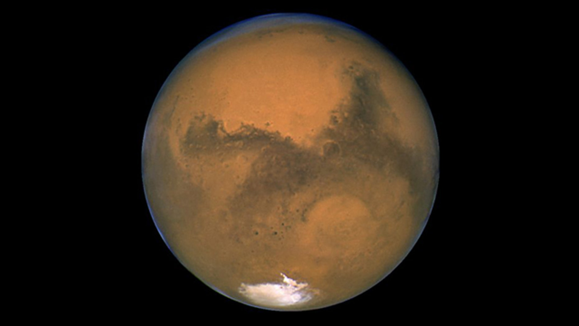 Hubble portrait of Mars taken Aug. 26, 2003 -- it's closest proximity in 59,619 years -- showing Hellas Basin.