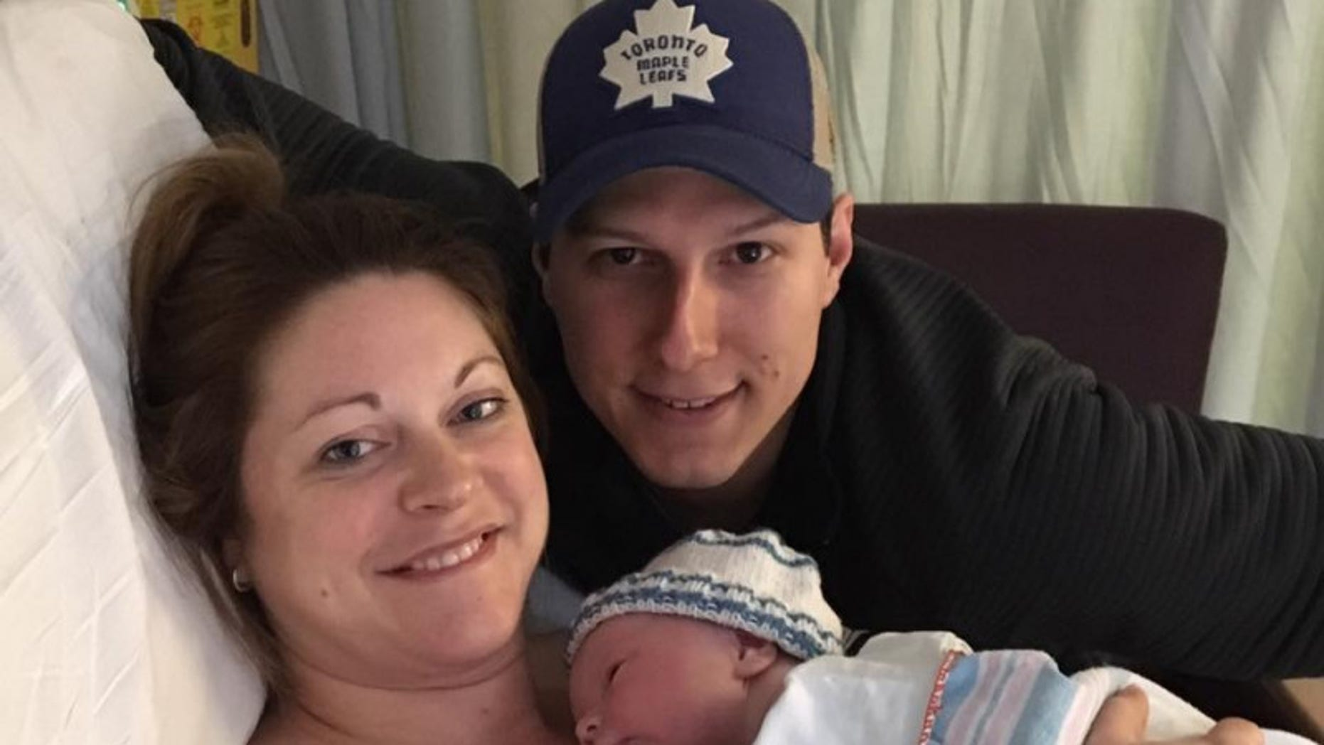 Lindsey Hubley is pictured with her newborn son and fiance. Days after this photo she was diagnosed with a flesh-eating bacteria infection.